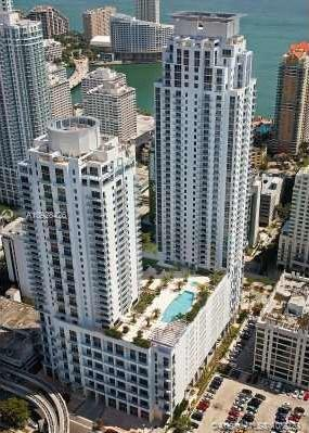 Penthouse, loft 13' ceilings, skyline + partial bay views, in the heart of Brickell, close to the restaurants, Brickell City Centre, Publix, train station, amenities include oversized pool deck, fitness center, billiard room, 24 hours concierge, 24-hr valet, pet friendly, slate floors, marble counter tops, stainless steel appliances, electric blinds, washer, dryer, location, location, covered assigned parking, EZ to show.