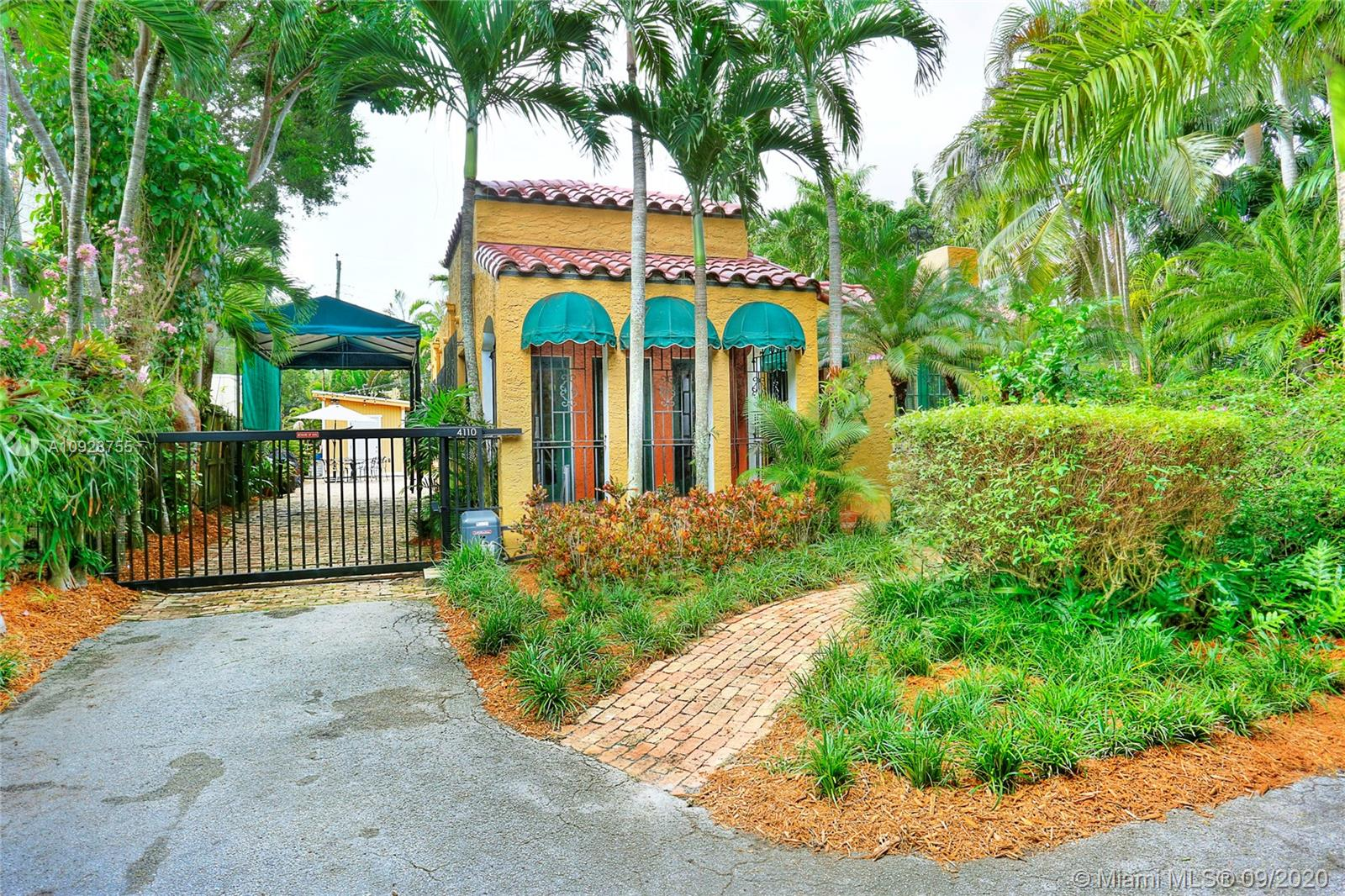 "Captivating bungalow tucked away on a quiet, tree-lined street in lush South Coconut Grove. Featured in the book ""The Tropical Cottage- At Home in Coconut Grove"". 2BR/1BA main house + 1BR/1BA guest house. Light-filled living spaces with original architectural details including gleaming wood flooring, original paned windows ( circa 1924), fireplace & volume ceilings. Living & dining rooms + large den/office that opens to an inviting screened porch. Renovated kitchen features classic white wood cabinetry & stainless appliances. Enjoy outdoor living & entertaining on the ultra-private expansive bricked terrace. Walk or bike to the Grove village center's galleries, boutiques, cafes & bayfront parks & marinas. Just minutes to Coral Gables, South Miami & Key Biscayne."