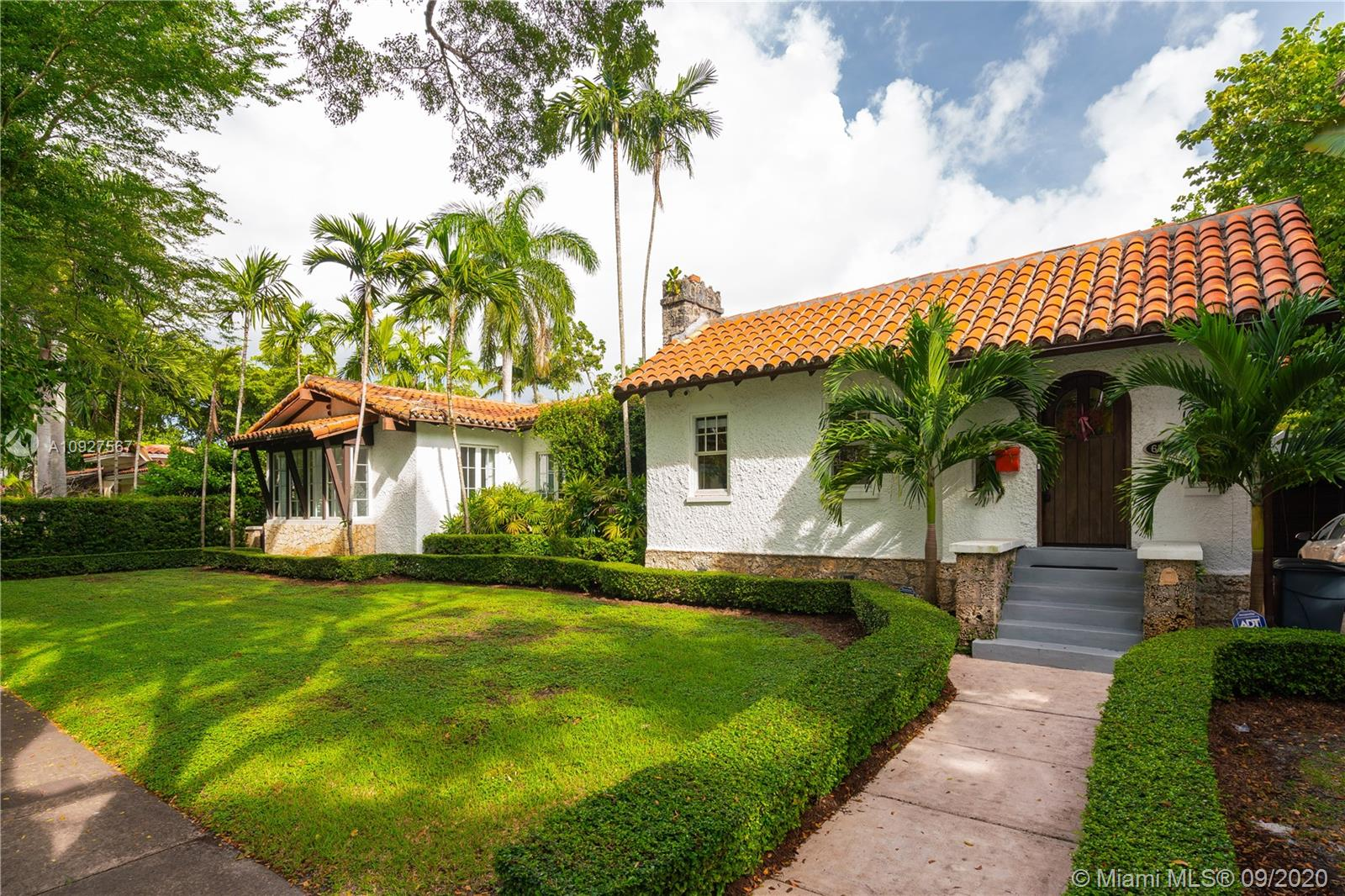 Historically designated 1922 built 5 bedroom 3 bath 3000 sq ' Coral Rock Craftsman charmer on a 10,000 sq ' lot was the 25th home built in Coral Gables and the 1st on Alcazar Ave. In 2006, renowned architect, Nelson de Leon designed an addition, more than doubling the size of the original house & achieving the dazzling and almost impossible feat of constructing a brand new addition that was completely in harmony with the original. Turn-key condition throughout. Splendid outdoor living spaces, poolside courtyard. Exceptionally spacious master suite with huge bath & walk-in closet. High ceilings. Fireplace. Great storage. Top Gables location - EZ walk to downtown, Granada GC & 15 minutes to Miami International Airport. Today's modern conveniences paired with the charm of yesteryear!