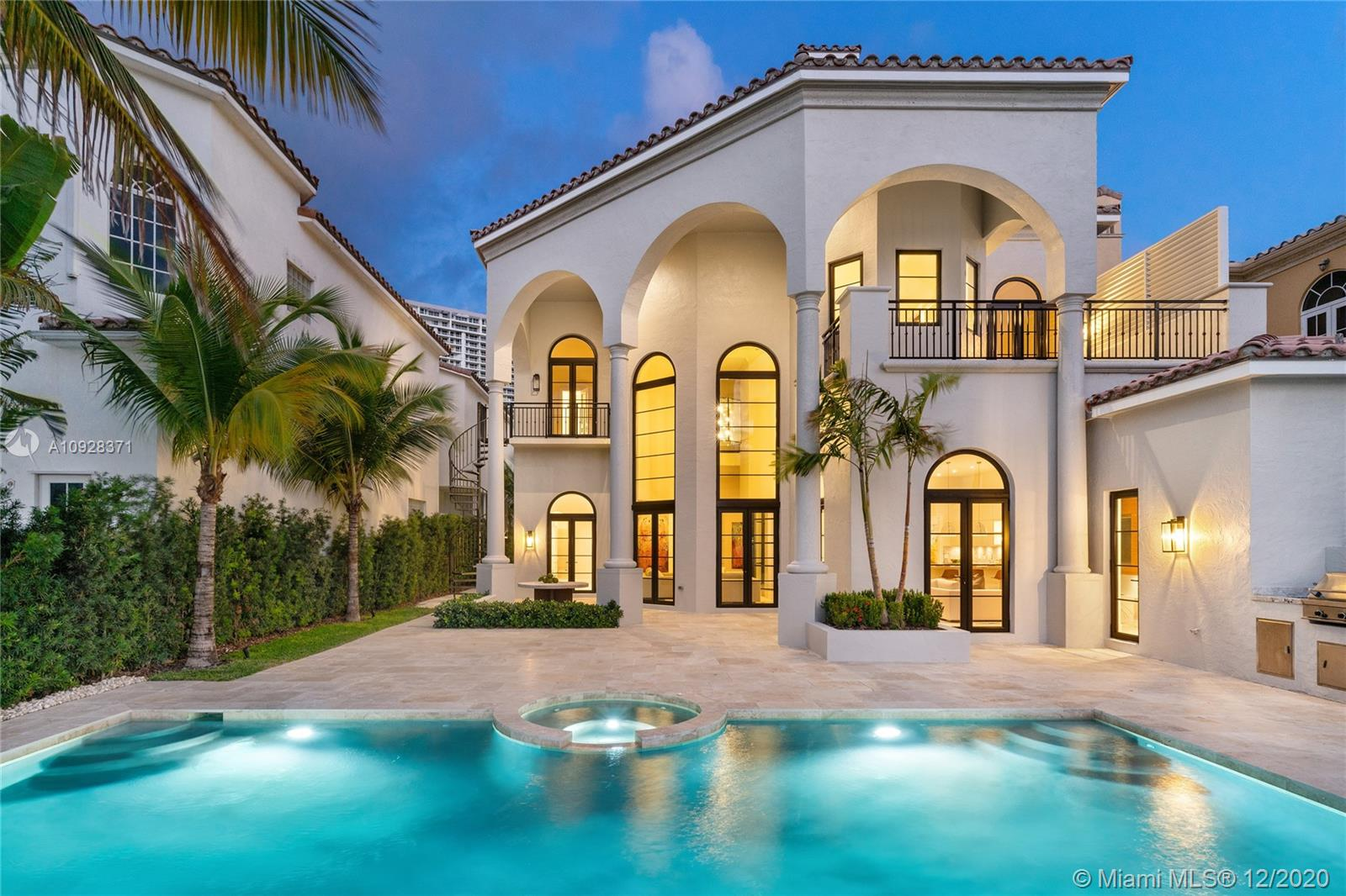 ISLAND ESTATES *** 100 FEET DOCK SPACE AVAILABLE *** HOME COMES WITH A 55' DOCK SPACE **** THIS IS THE ONLY HOME WITH WATER VIEWS IN THE FRONT AND BACK. EXCLUSIVE AND PRIVATE ISLAND ESTATES - A SOPHISTICATED AND LUXURIOUS RETREAT WITH ONLY 22 HOMES THAT REFLECTS MAGICAL MERGING OF INSPIRATION AND ARCHITECTURE. SPECTACULAR WATERFRONT MANSION! STUNNING INFINITY POOL AND BREATHTAKING VIEWS INTRACOASTAL. COMPLETELY REMODELED TO PERFECTION. SOARING 30 FOOT CEILINGS - GLEAMING TRAVERTINE & OAK FLOORS, FABULOUS ARCHED WINDOWS, ELEVATOR AND MORE. GENEROUSLY SIZED FORMAL DINING ROOM. FABULOUS GOURMET KITCHEN WILL INSPIRE YOUR INNER CHEF. AS A BONUS - HOMEOWNERS HAVE ACCESS TO ALL PRIVE AMENITIES AT NO ADDITIONAL COST! PRIVATE ROAMING PATROL GUARD 24/7.  ONE OF A KIND HOME!