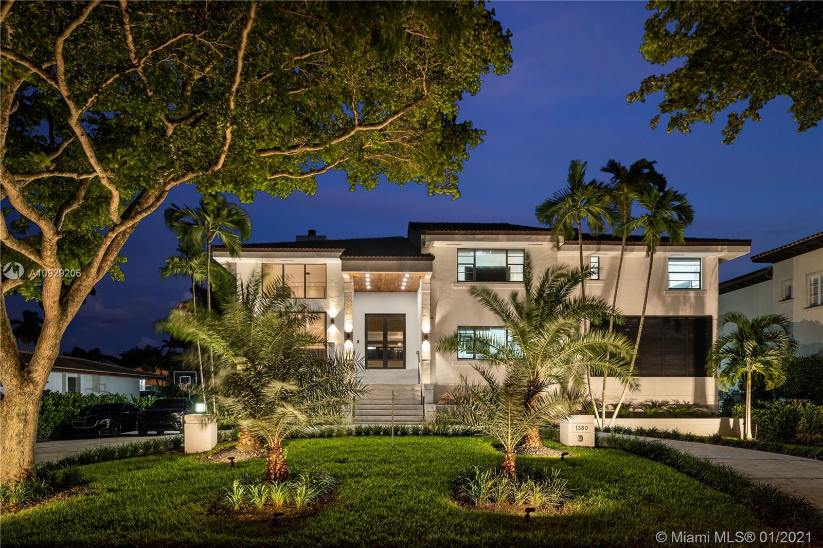 Magnificent Modern Masterpiece! Located in Guard-Gated Gables by the Sea on a 12,000 SF waterfront lot. This 5 bed 6.5 bath home offers 3 floors of luxury living with state of the art features. Dramatic double height windows, glass staircases, spectacular water views, en-suite bedrooms & home gym will not disappoint. Enjoy the combined family room & gourmet kitchen with Thermador Appliances that overlook a resort style patio. Elegant wood ceilings cover the outdoor living area equipped with custom TV's, a new age summer kitchen & breathtaking Sunrises and Sunsets! The living room is dazzling with a quartz finished fireplace & the dining room has a one of a kind glass enclosed 380 bottle wine cellar. The media/card room with TVs & wet bar is perfect for spending time with family and friends