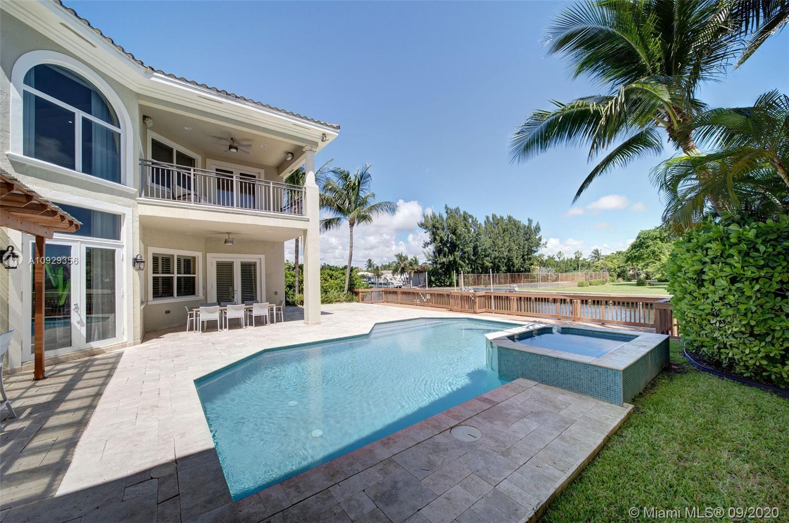 This luxury waterfront 2-story home is nestled on a quiet cul-de-sac in the prestigious guard/gated boating community, Three Islands. This home features 5 BD/4.1 BA, and boasts 65 ft water frontage, private dock and boat lift with ocean access. Spacious floor plan offers generous open kitchen with island, breakfast nook and family room. Elegant formal dining. Living room with double height ceiling. Spacious Master Suite includes his/hers walk-in closets, sitting area and private terrace with intercoastal views. The backyard is a tropical oasis with covered patios, summer kitchen, and heated pool with spa. 2 car garage + storage. Turnkey ready. Amenities include clubhouse, fitness center, tennis, playground, and basketball court. Short drive to beach, world famous shopping and dining.