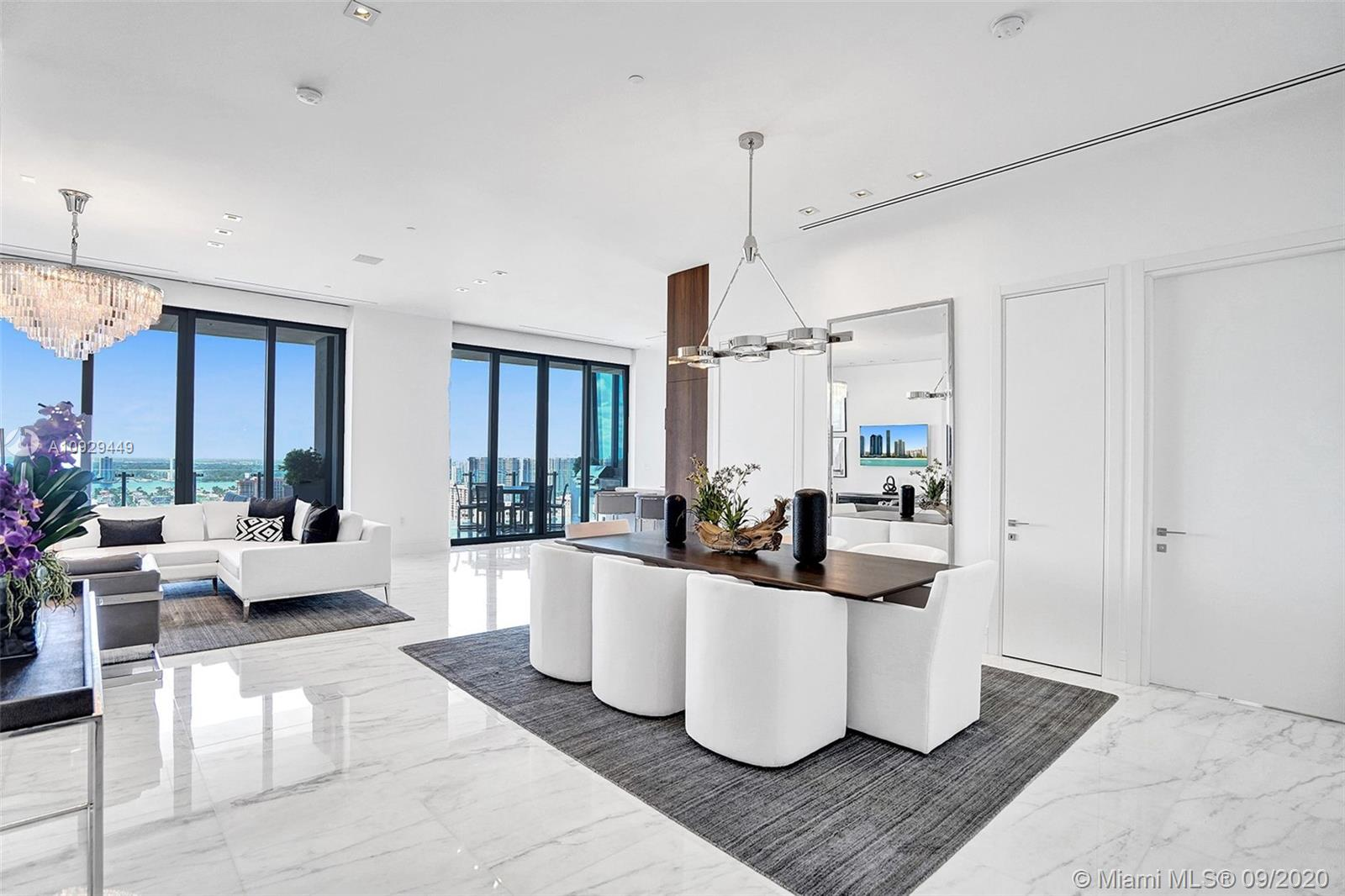 Absolutely Stunning, designer finished 2/2.5 in the Ultra-Exclusive and Luxurious Muse in Sunny Isles. The Massive terrace with Sweeping intracoastal & city views becomes a second living & dining space with an outdoor grill, dining area & a lounging/entertaining space. This smart home is full of exceptional features: lighting, shades, audio & video integration, Calacutta marble flooring throughout and 11+ ft ceilings.Designer Italian kitchen w/dual temp wine cooler, Wolf & Subzero appliances.The Master suite is complete with a midnight bar, beautiful walk-in in closet, soaking tub, rain shower, disappearing TV behind mirror. Muse's personalized service available at the restaurant, the pool, spa & the beach.Enjoy the best of luxury resort style living in Sunny Isles' best boutique building.
