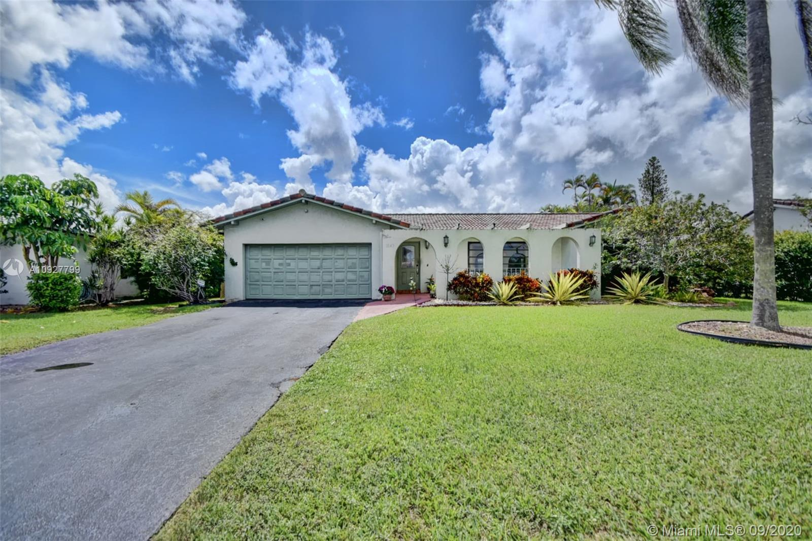 Fantastic 4 bedroom, 2 bathroom home with a pool and on the water in the beautiful Ramblewood community in Coral Springs! Home features a split floorplan, renovated kitchen that is open to the oversized family room.  The garage is converted.  Stunning views of the water and pool right from your kitchen! NO HOA!! Roof replaced in 2007! Located close to major highways restaurants and shopping!