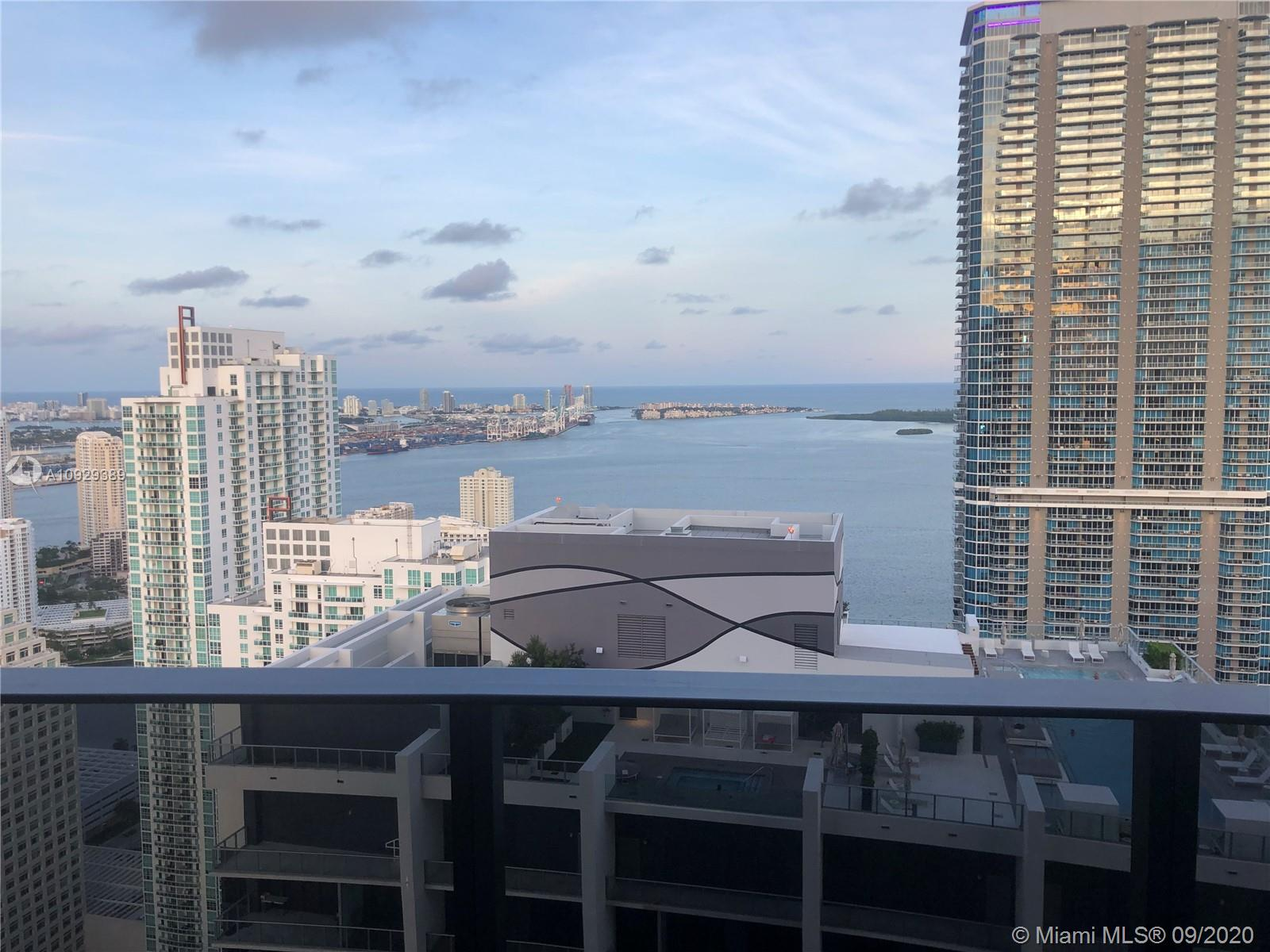 Worldclass views from this 2 Bed + Den/2.5 Bath Lower Penthouse at Brickell Flatiron with higher ceilings. Downtown Miami's hottest neighborhood celebrates a true architectural icon. These luxury Brickell condos located at 1000 Brickell Plaza are an urban oasis developed by Ugo Colombo and designed by Luis Revuelta. The tower of soaring glass, defined by sweeping exposures, enhances the skyline with persuasive curves. Inside, Italian interior architect Massimo Iosa Ghini introduces a design concept of fluid, continuous space by creating a seamless transition from Brickell Flatiron's exterior. Italian Porcelain floors, Snaidero kitchens, and a great floorplan create an incredible home in the sky. Rooftop pool, spa, Sauna and fitness center with Pilates/yoga and aerobics studio.