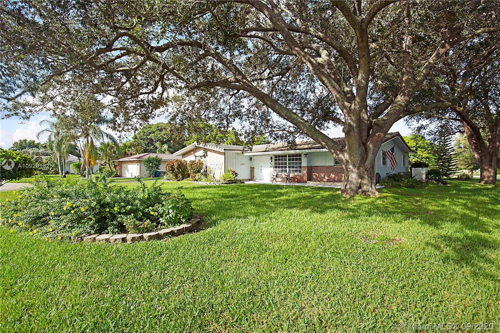 Opportunity to make this home your own in Coral Springs! Situated on a large 13,033 sqft lot and located on a cul-de-sac this 3 bedroom 2 bath home has a lot to offer. Long driveway w/ 2 car side load garage. Large front porch overlooking the expansive yard. Inside features a split floor plan. Master suite features walk in closet and en-suite. Generous bedrooms sizes. Florida room off the back of the home w/ a great use of additional space. Hurricane Shutters. NO HOA. Watch the video tour of the home: