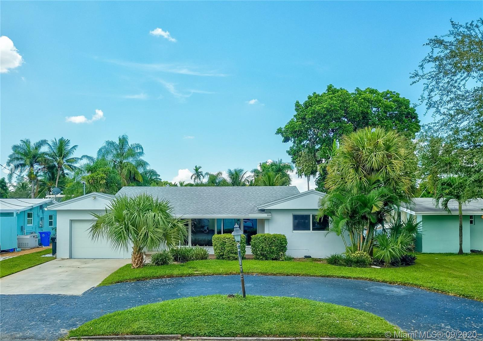 Beautiful waterfront pool home with garage. Home has direct ocean access with 65' on the water and no restrictive bridges. Boaters Paradise. Live the luxurious florida lifestyle at a fraction of the price. This is the LAST of affordable deep water ocean access homes in South Florida. LED's lighting throughout. Your insurance company will love you for the newer roof, newer ac, upgraded electric panel and upgraded to impact windows. This home is eager to be transformed by your cosmetic preferences. Architectural drawings available for buyers wishing to add a third bedroom & bathroom.