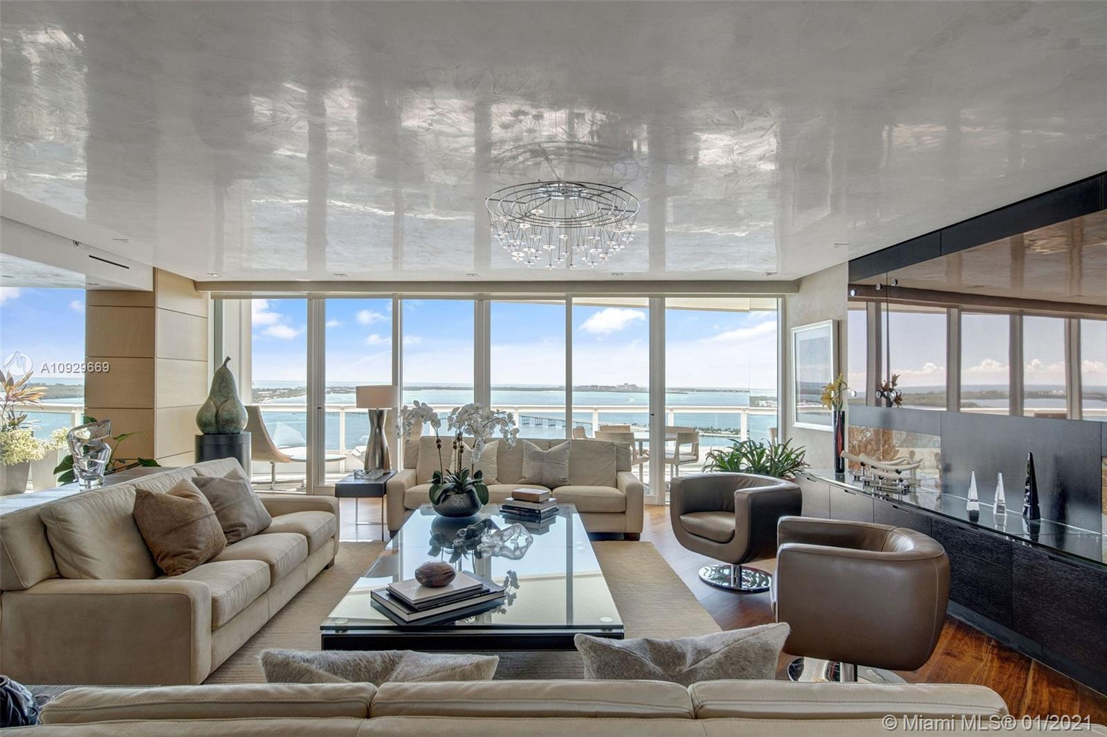 Spectacular oceanfront east-west flow-through condo at Santa Maria, stunning views of Biscayne Bay and Miami skyline. Elegant residence renovated with custom and crafted detail. The rivate elevator opens to the spacious living room with beautiful ocean views and great lighting. Very generous space: 4 bedrooms, 5 1/2 baths, custom kitchen, and closets. Unit 3004 is a smart unit with motorized window treatments, Lutron lighting, and AC controlled from a smart device. 
