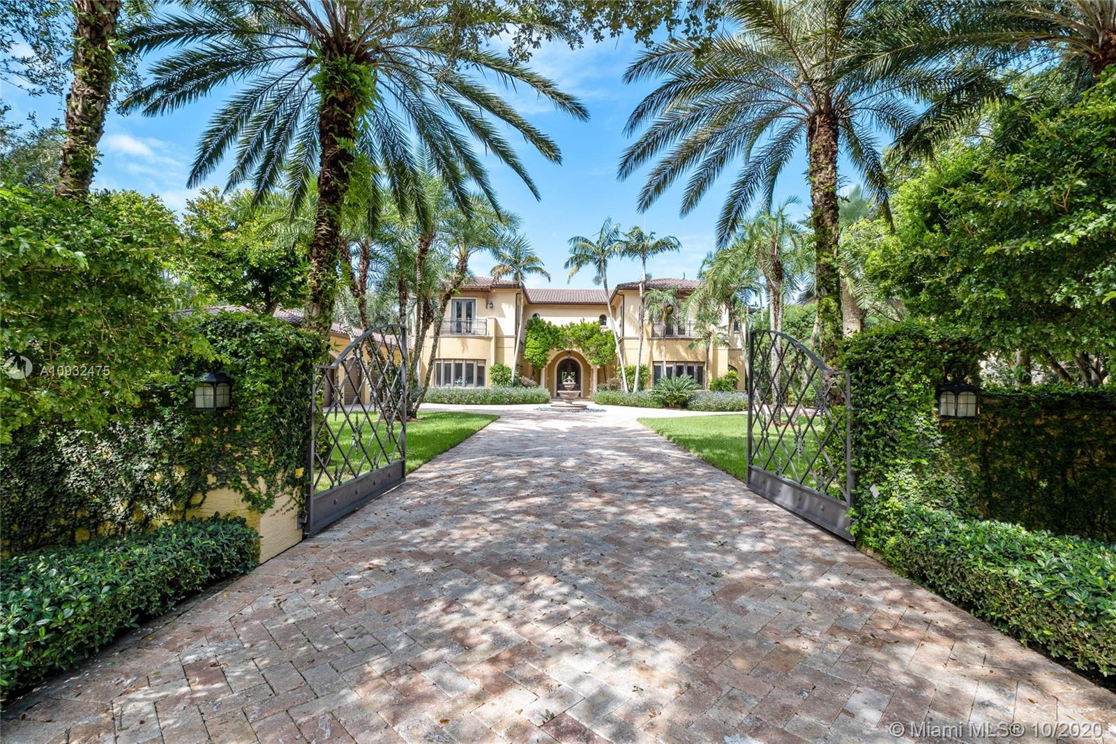 Opulent, Crestron-powered Smart home on gated acre+ lot in Pinecrest. The expansive layout boasts 7 bdrms/ 7.5 baths, grand foyer, stately archways, formal dining rm w/ butler's pantry & custom millwork. Gourmet kitchen w/ 2 islands, Viking & Sub-Zero appliances, built-in coffee maker & large breakfast rm. The regal master suite has adjacent sitting area w/ balcony, & the master spa offers his/her vanities, spa-jet tub & built-in makeup vanity. Impact glass windows frame incredible views of the grounds w/ 2 covered terraces, bullt-in bar, large pool w/ spa & outdoor grill. Added conveniences include 1st & 2nd-floor laundry rms, additional covered drive w/ access to the kitchen & 3-car garage. Be the next to own this unique & private luxury compound w/ the very best in design & technology.