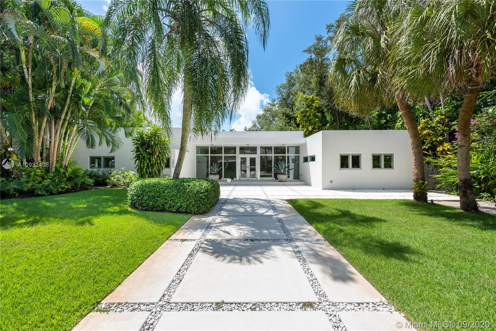 """Contemporary Miami modern home is the ideal combination of modern architecture simplicity and an indoor/outdoor lifestyle. An open concept of sophisticated living space offers an abundance of natural light and sublime pool views. A glass backsplash with customized stainless steel cabinetry and a large waterfall countertop sets a sleek tone in the kitchen. This home features 4 bedrooms, 4.5 baths, high impact Clerestory windows, and polished concrete floors throughout. Nestled in the coveted 24/hour guard-gated enclave of """"The Moorings"""" a bayfront community with a private marina, 3 parks, and direct ocean access. Walk or bike to Downtown Grove Restaurants, shops, and some of the best private schools."""