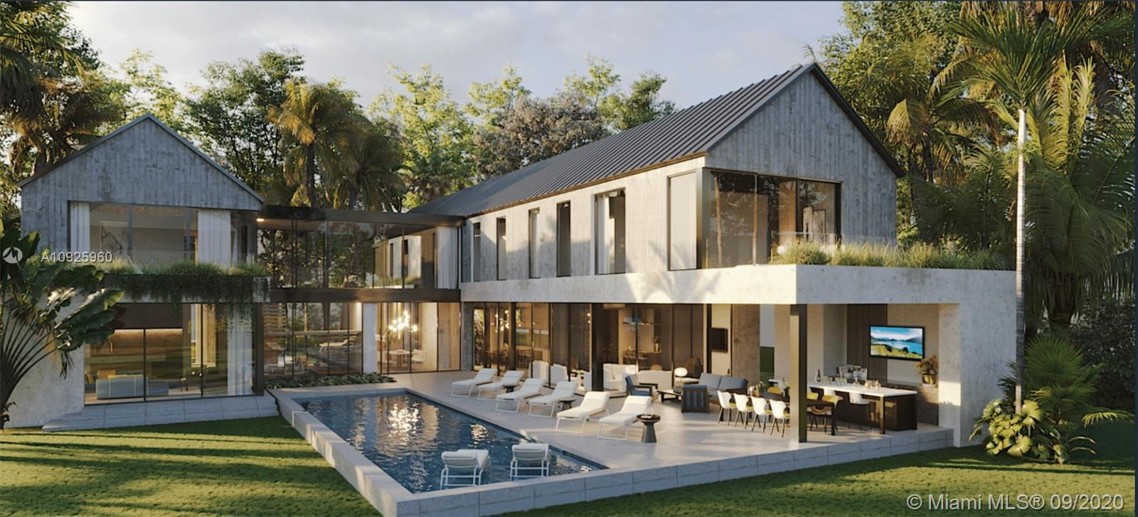 """Extraordinary Modern Farmhouse """"Built for the Ages"""" by Mocca Construction. Commanding a private wooded acre in posh, close-in Ponce-Davis, the home rises amidst majestic stands of live oaks. Organic features include Florida Keystone & natural woods. Its H-footprint & floor-to-ceiling windows/doors optimize landscape & reflecting pool views. Understated interiors flow seamlessly into vibrant outdoor living spaces. Of its elegant 11,762 SF, 9,015 are under air, including lofty common areas, a heart-of-the-home kitchen, en-suite sleeping quarters, guest suite, staff quarters, office, 6 baths & 3 half baths. Exteriors include covered lounge, summer kitchen & luxe lap pool. The grandly scaled Max Strang-designed residence's expected completion date is Spring 2021. Worth the wait!"""