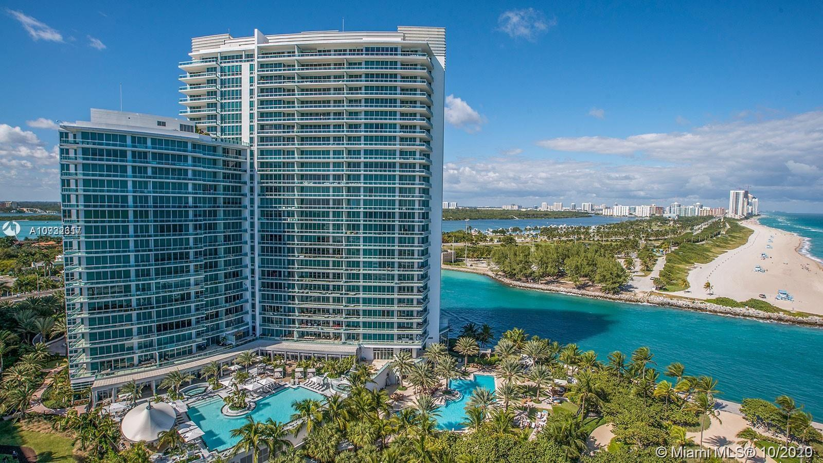 STUNNING CORNER UNIT WITH WRAP AROUND BALCONY OFFERING BEAUTIFUL VIEWS OF THE OCEAN, HAULOVER CUT, OLETA SANDBAR AS WELL AS A A BEJEWELED SUNNY ISLES AT NIGHT. 2 BEDROOM/2.5 BATH LUXURY UNIT ON A HIGH 11TH FLOOR AT THE RITZ CARLTON BAL HARBOUR. LIVING IS HAS A DAILY LIGHT EXPOSURE WITH FLOOR TO CEILING WALLS OF GLASS BEING IN THE CORNER OF THE BUILDING . PRIVATE ELEVATOR TO THE APARTMENT WITH CENTRAL FOYER ACCESS, DINING ROOM, LIVING ROOM & FULLY EQUIPPED KITCHEN / WOLF & SUBZERO APPLIANCES, GORGEOUS ITALIAN CABINETRY, WASHER & DRYER. KING BEDS IN BOTH BEDROOMS WITH A QUEEN SIZE PULL OUT COUCH. RITZ CARLTON RENTAL PROGRAM IS OPTIONAL. LUXURY HOTEL AMENITIES INCLUDE POOL & BEACH, SPA, RESTAURANT, GYM AND HOUSE CAR. CLOSE TO BAL HARBOUR SHOPS AND PLACE OF WORSHIP.