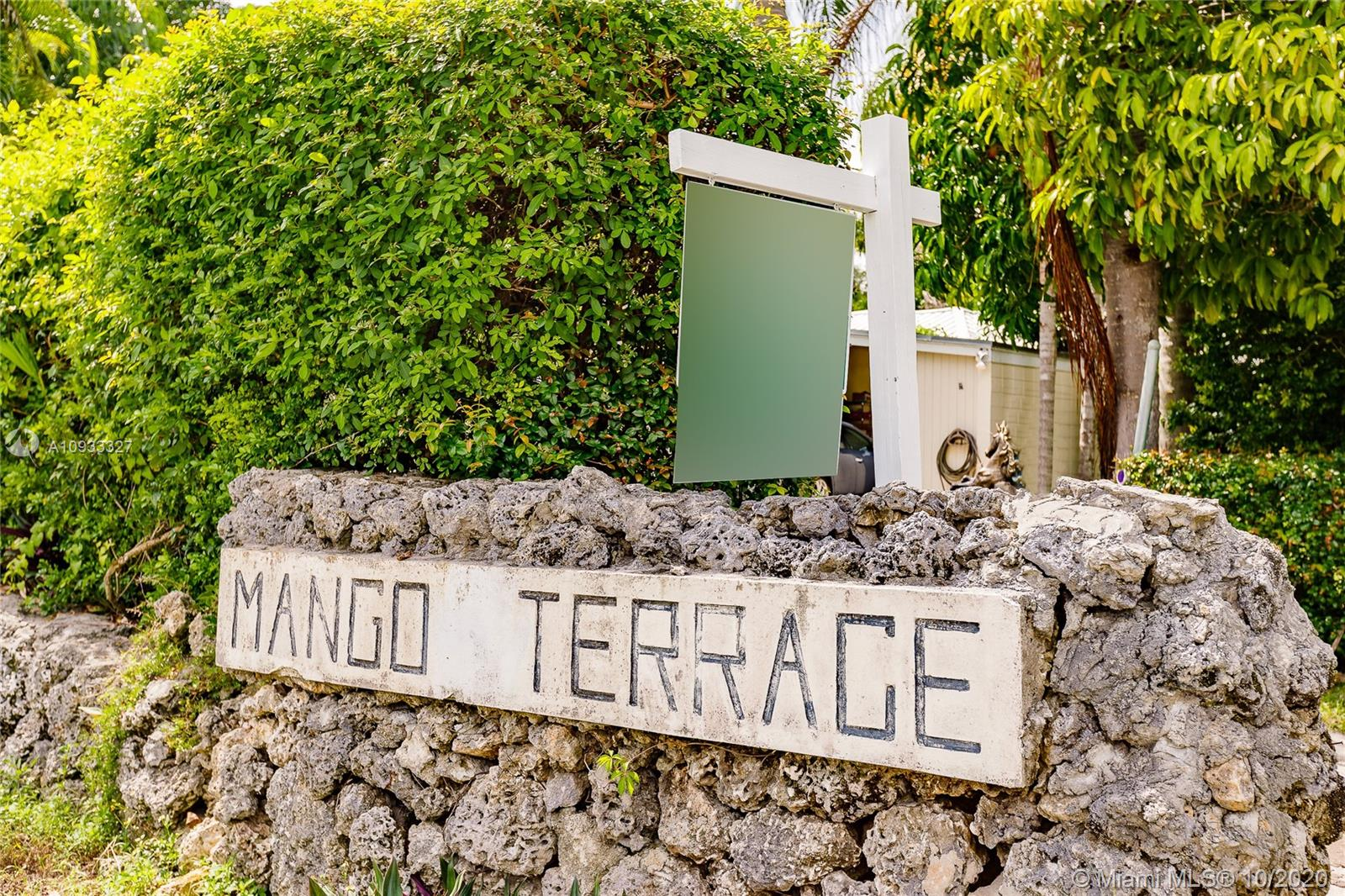 RARE FIND: 3 bedroom 2 bath 1 covered carport home on 11,999 Sq. Ft. lot at sought after  Mango Terrace. Property has impact windows, new roof, alarm system, appliances, hard wood floors, skylight in master bath, fence around property and a Certified State Farm Inspection for insurance. West side of house can be converted to a kennel. East side of house provides access to back yard and ability to park an RV or boat. Huge back yard with mango and shade trees provide a relaxing oasis with plenty of room for a pool or additions. Great home for entertaining with ample parking around it. Centrally located close to Metro Rail, major highways, UM, Dadeland & South Miami nightlife/restaurants. Quiet, arbored, well kept neighborhood for pleasant walks at one of South Floridas best places to live.