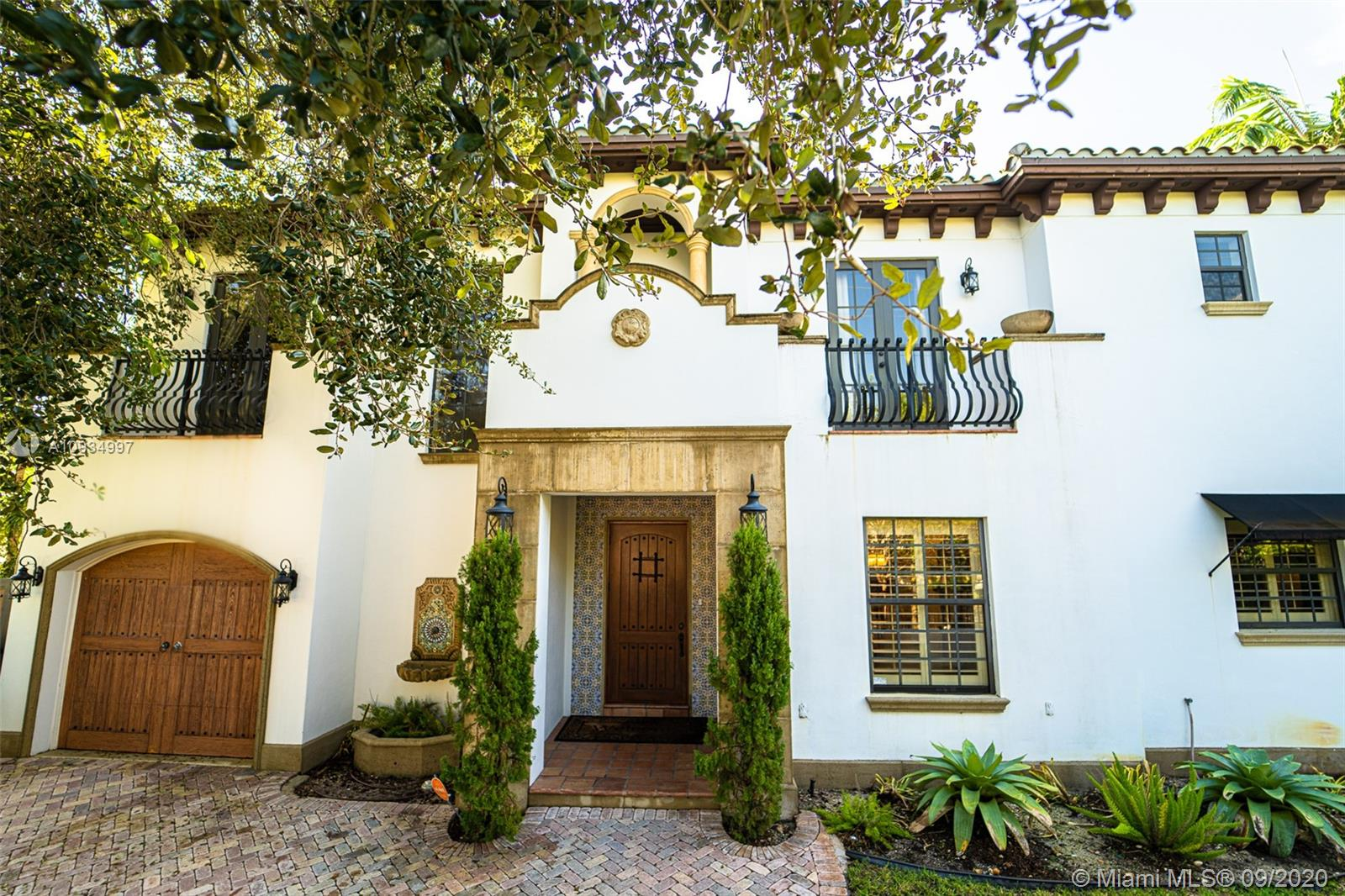 Beautiful 5 bedroom 4 bathroom two story Spanish Villa-style home in the heart of The Roads/Grove. Formal living and dining room, fireplace, gourmet kitchen with granite countertops and stainless steel appliances. Amazing master suite with private balcony and huge marble spa bathroom. Custom multimedia system throughout the house. Beautifully tiled floors with original crown molding throughout the home. Impact windows, pool & generator w/propane tank to run the whole house. Minutes from everywhere you want to be: Downtown, The Grove, South Miami, Miami Beach, Midtown, Key Biscayne and Coral Gables.