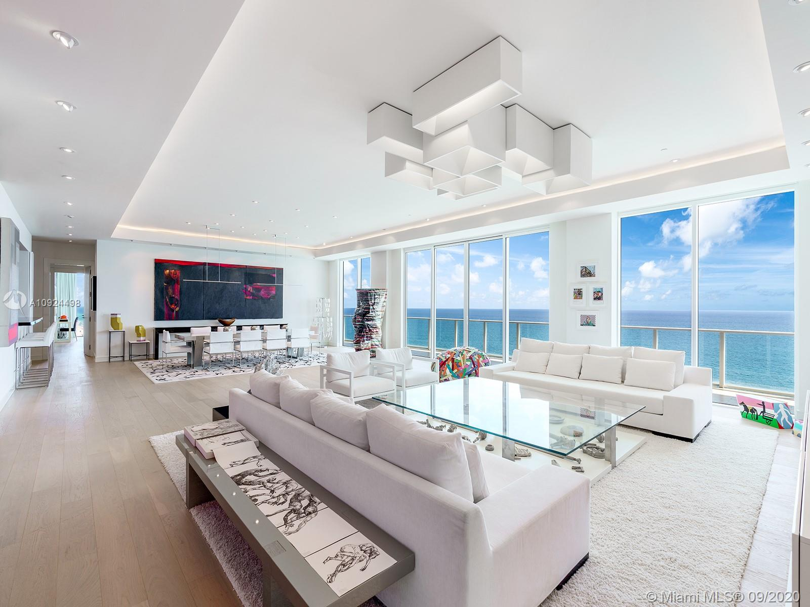 The penthouse at Apogee Beach was completely custom designed to be a luxurious home for entertaining and grand living and is now on the market for the first time. Atop this boutique building designed by renowned architect Carlos Ott, the full-floor residence features extraordinary views in every direction from its many outdoor spaces, including the all-encompassing balconies on the east & west facades, an expansive rooftop deck with outdoor kitchen and private pool, and a private poolside cabana downstairs. Show stopping interiors with high ceilings and pale wood floors, massive living room, and a master suite complete with private office. The building offers an extensive roster of amenities, including over 240ft of ocean frontage, pool, fitness center, club room, theater, and kids lounge.