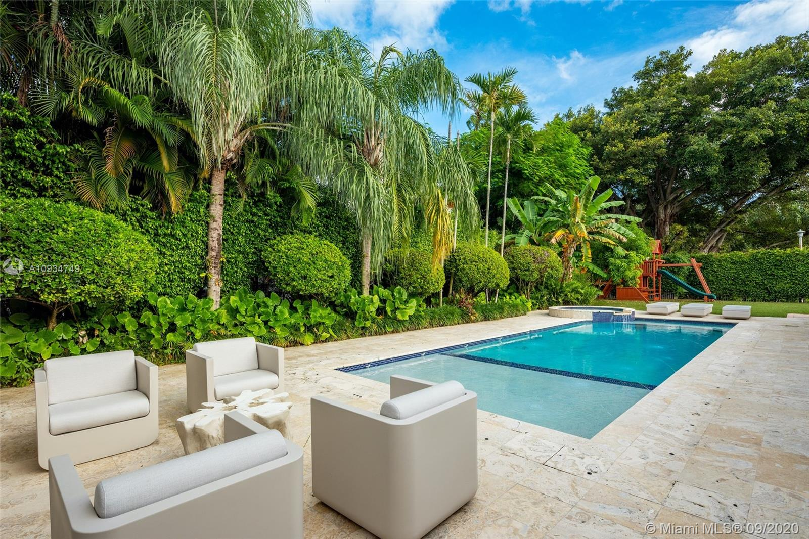 Enjoy living in prestigious gated Bay Point, one of the most exclusive gated communities in Miami. This well-manicured home sits on a picturesque quiet street. Boasting 7 bedrooms, 8 full bathrooms & 1 half bath, this 6,373 total square foot smart home sits on an expansive 19,951 square foot corner lot. Luxurious features in this renovated contemporary home include a spacious open layout with natural light pouring in, modern gourmet kitchen with Wolf and Miele appliances, a large principal suite with a sitting area & dual sinks and walk-in closets, maids quarters & brand new addition to the home adding a second story & additional bedrooms. The outdoors are perfect for entertaining with a beautiful pool, bbq area & covered outdoor lounge area made for outdoor living. 24/7 Bay Point security