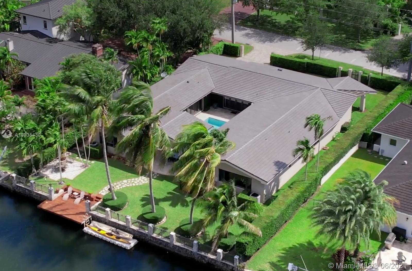 This gorgeous home is on the Coral Gables Waterway with its own dock and is just a 15-minute boat ride to beautiful Biscayne Bay. This gated property is close to shops of Merrick Park, less than 3 miles from exclusive shopping, international cuisine and entertainment of Miracle Mile. Close to both family-friendly Riviera Country Club and prestigious Biltmore Hotel golf course. Providing amenities such as gym, summer camp for kids, pool and many more! Outside, find plenty of entertainment space on the sun-soaked terrace just waiting to host friends and family in the sparkling pool and spa or while unwinding from a long day enjoying a meal under the covered patio.