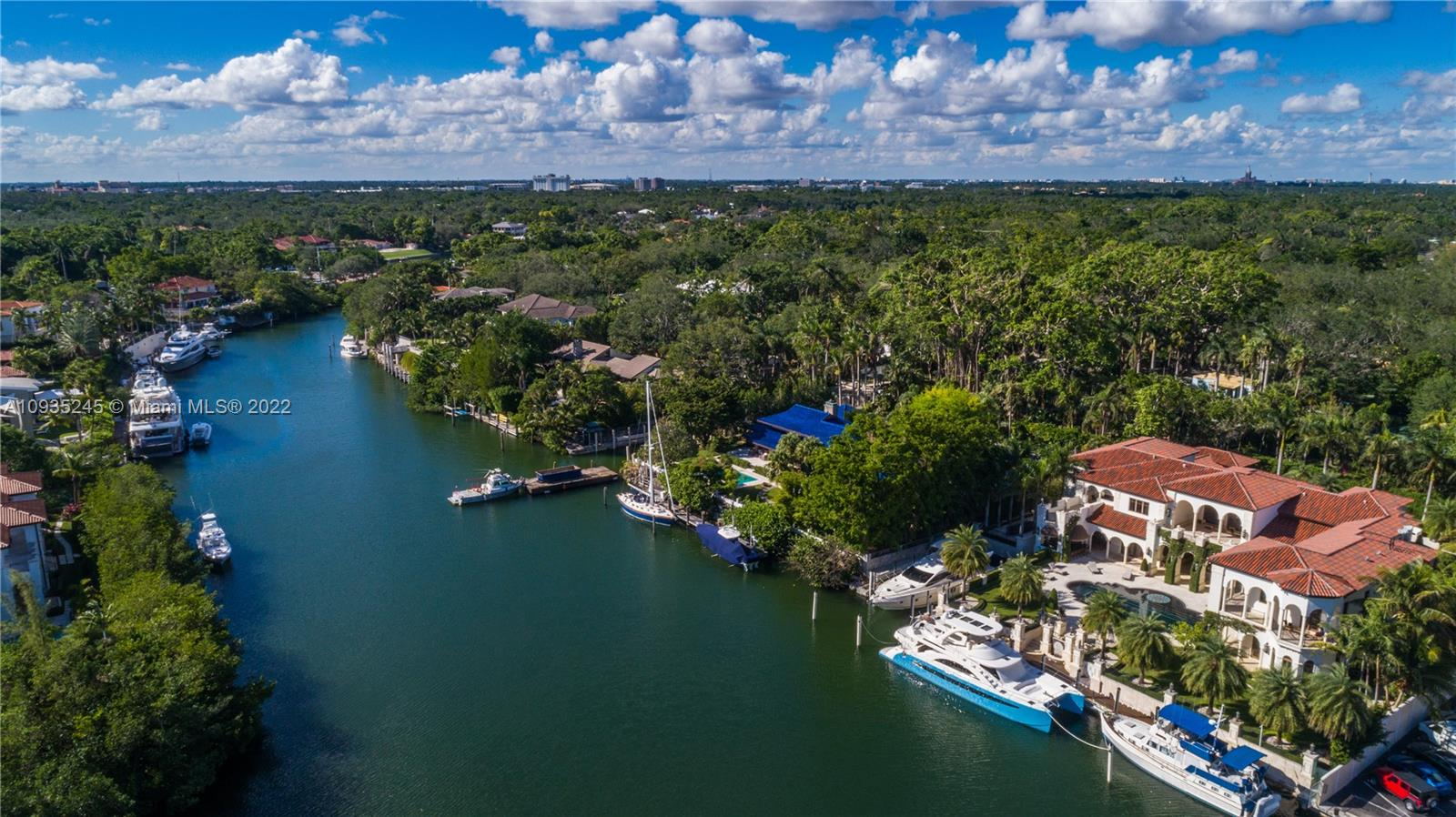Elegant 13,889 sq ft (LA) Mediterranean style estate, located on prestigious Edgewater Dr., boasts 180 ft water frontage, private dock and deep 80 ft inlet slip with no bridges to bay. Privacy provided by additional 9,539 sq ft driveway/easement leading to garage/carports for 8+ cars. Luxurious 10 BD, 11/2 BA include soaring ceilings, 2 Master Suites, chic kitchen, dual staircase, 2 separate maid's quarters and 2 elevators. Multiple terraces overlook Gables Waterway, large backyard with pool and impressive outdoor kitchen.