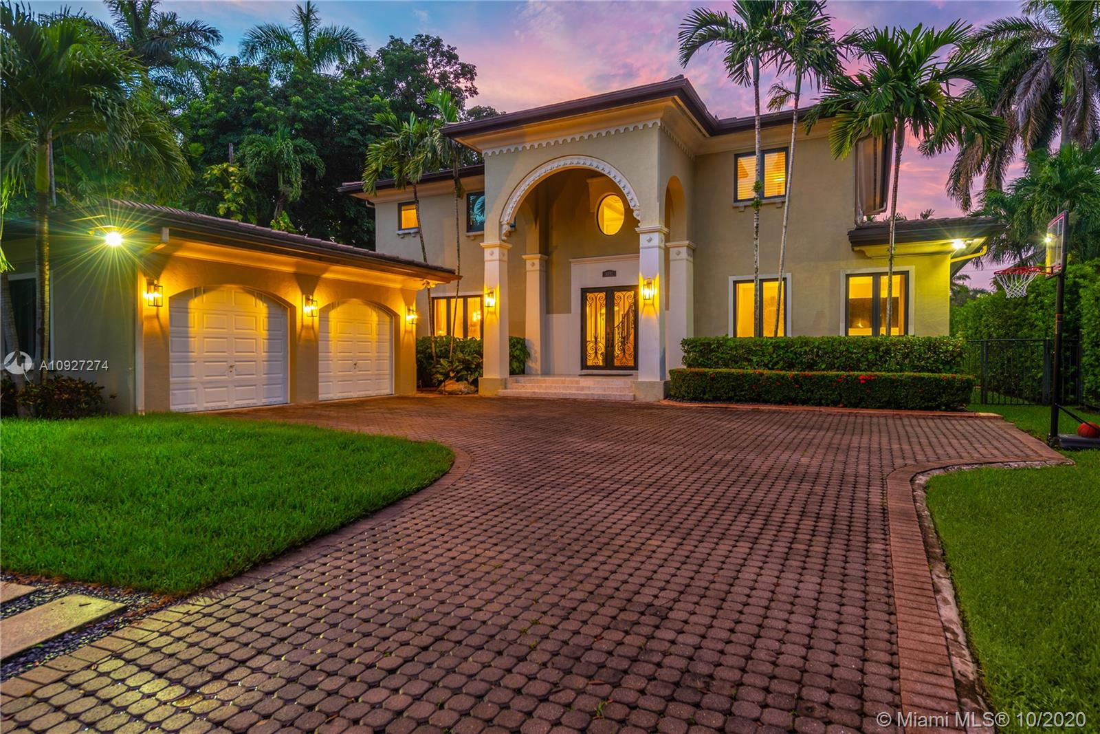 Gorgeous, fully gated home situated on a tranquil street on one of S. Miami's most coveted neighborhoods. This meticulously appointed home features a grand marble staircase with volume high ceilings upon entry. Spacious and inviting, this Smart Home offers formal living and dining areas, Chef's kitchen with top of the line appliances, an adjacent family room which overlooks a pristine pool. Guest bedrooms are ensuite with large custom walk in closets.The Master bedroom suite includes a newly remodeled bath and huge 200SF walk in closet.Surround system (indoor/outdoor), LED lighting, full house generator, GarageTek system in the 2 car garage are a few of the many extras this residence offers. Close proximity to nationally ranked schools, the best hospitals and Dante Fascell Park.