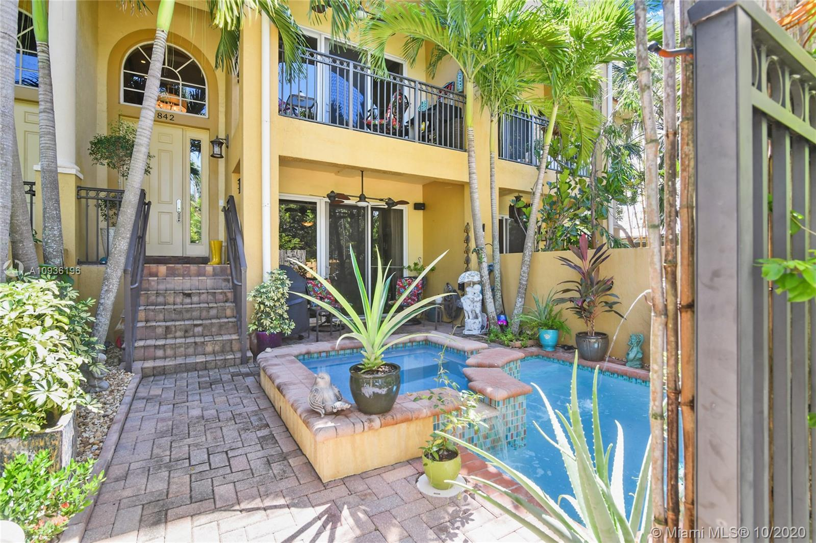 Exquisite Tri-Level Townhome in the heart of Wilton Manors.  This home has been upgraded with magazine quality finishes.  Custom Chefs kitchen featuring Samsung appliances, quartz countertops, center island and an abundance of cherry cabinets.  Formal dining room and living room features a balcony overlooking the private pool and spa.  Stunning master suite with oversized walk in closets, walk in spa quality shower, jetted tub and private balcony.  Second bedroom also offers a private suite.  The third bedroom is perfect for guests offering a bar, full bathroom, mini kitchenette and views of the courtyard.  Oversized 2 car garage!  Fee Simple and low HOA fee!  Located on a quiet street, yet just 1 block to Wilton Drive.  Impeccably maintained and a must see! Owner is a Licensed Agent.