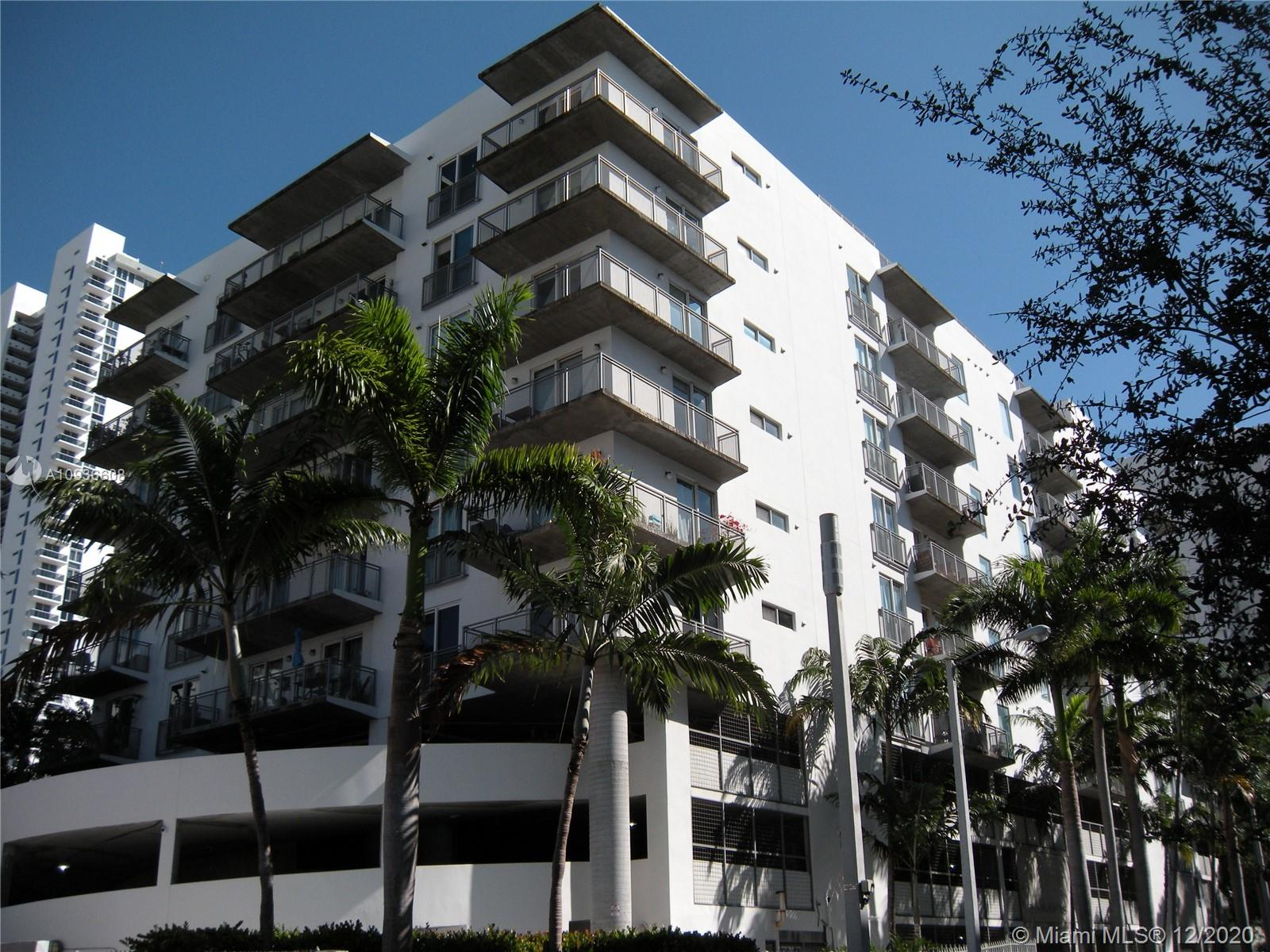 Two parking spaces on this industrial look 1/1.5 New York style condo loft located just minutes from Biscayne Bay in Miami's Design And Art District. This condo loft is located in the booming Wynwood/Edgewater area of Miami. Features include concrete floors, exposed 10ft ceilings, large balcony with Bay and City Views, wood kitchen cabinets, stainless steel appliances, washer and dryer in unit, open living and bedroom spaces, floor to ceiling hurricane proof glass doors, newer paint with decorator colors, walk-in closet and more. Unique 9 story building with pool, gym, club house, security cameras and electronic gates. Free water and trash. One year lease, mandatory association approval.