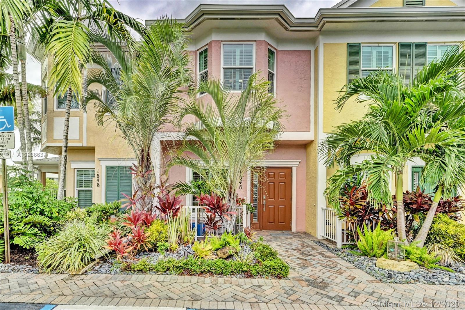 Beautifully renovated waterfront townhome is light & bright & ready for entertaining.  Located on the Middle River, walking distance to Wilton Dr. This Key West style home offers outstanding water views, community pool, dock, and plenty of open parking for guests!  Freshly painted, new central air conditioning(Feb 20), water heater (2019), new tile & crown molding throughout. This outstanding townhome offers a new remodeled kitchen with professional grade Kitchen Aid SS appliances, stylish backsplash, new quartz counter tops, sink, wine cooler & lighting, that opens to living & dining rooms with spectacular water views.  Impact windows & doors, new glass interior doors, Plantation shutters, motorized blinds. All baths have been updated. Attic space w ladder. Pet Friendly, Covered Parking