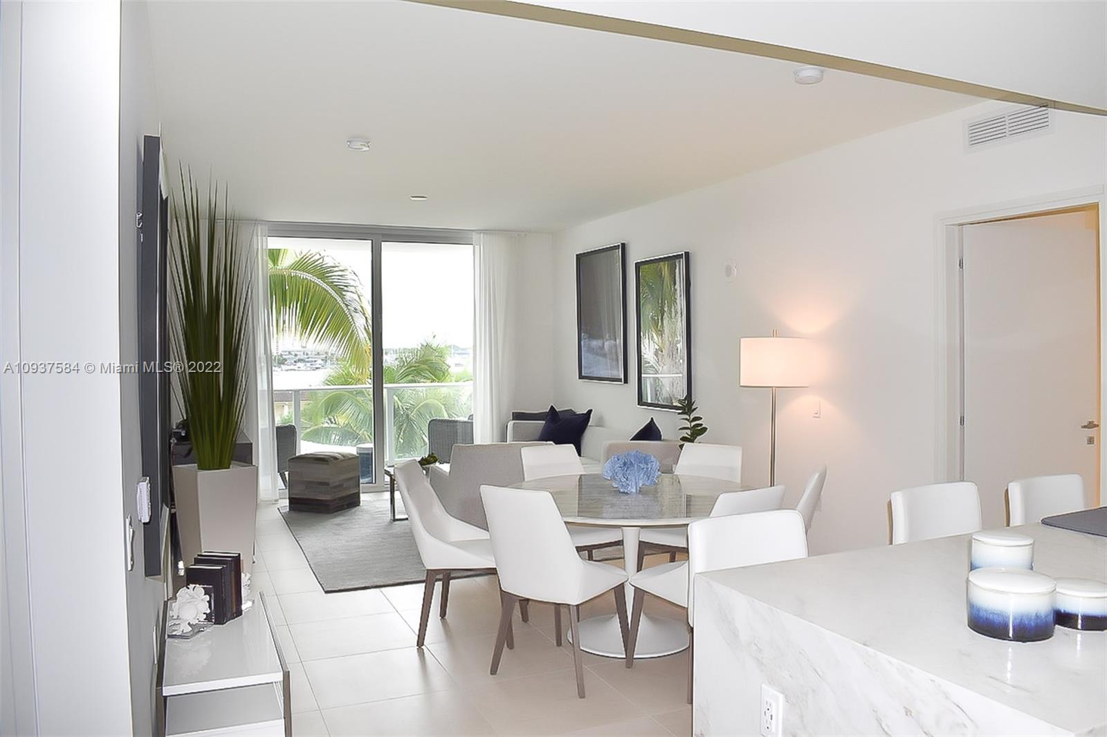 Beautiful 2 bedroom 2/1 bath plus Den!! brand-new contemporary building with five-star amenities surrounded by the Intracoastal Waterway and just 90 steps to the white sands of Fort Lauderdale beach. Inside residence 502, you will find 1,286 SF of open floor plan space, marble master bathroom with separate tub and shower, high end appliances, quartz countertops, 9-foot floor to ceiling windows, furnished by STEVEN-G . Relax on your balcony and catch an incredible sunset falling over downtown Fort Lauderdale. Enjoy resort-style amenities that include two pools, summer kitchen, theater room, fitness center, sauna, club room with kitchen, dining, and billiard lounge, 24-hour valet parking, and more — pet-friendly condo with no rental restrictions.