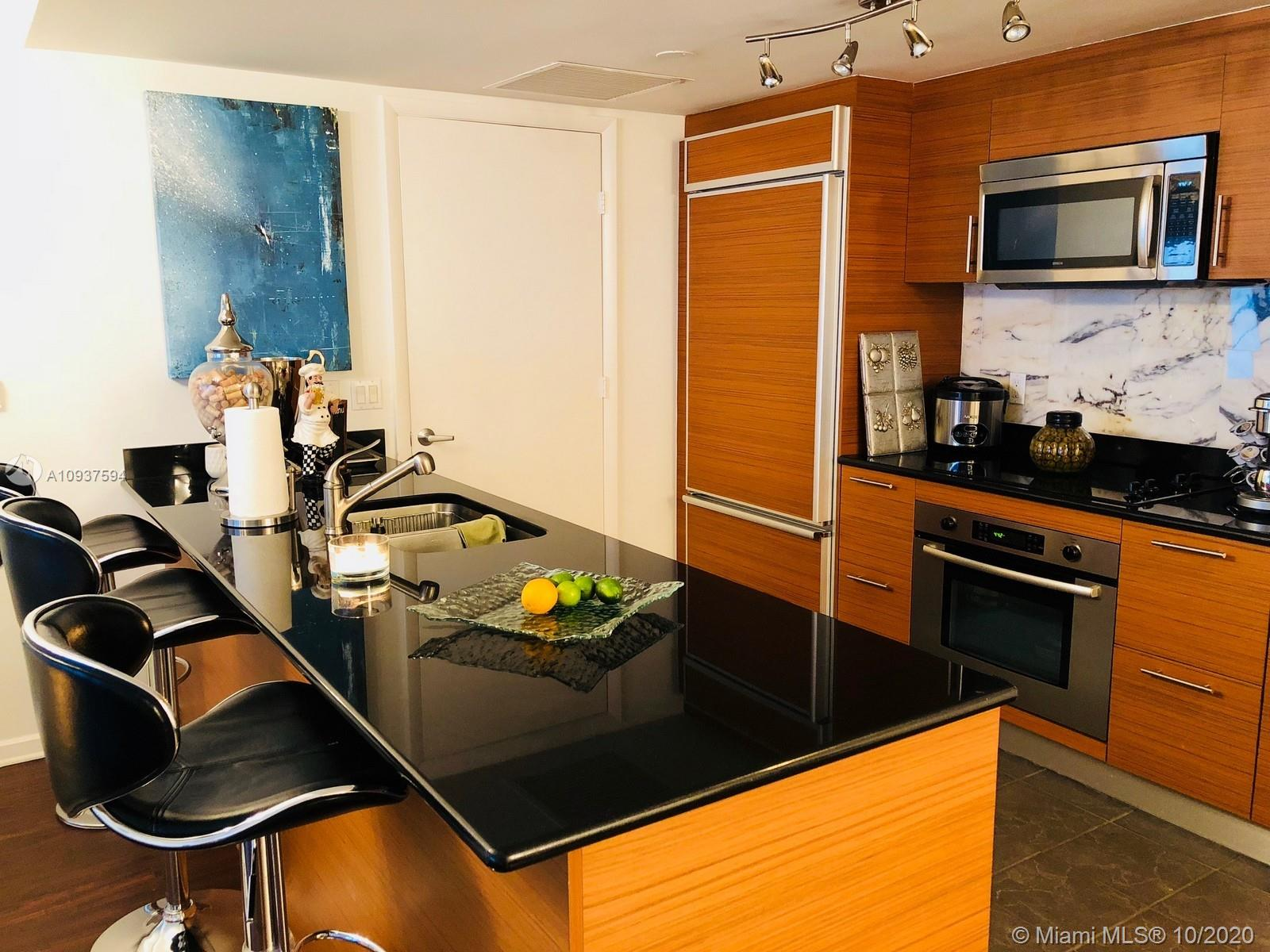 Beautiful unit available on spacious 2/2 + large DEN. The unit has been updated with wood floors, built-in closets and shades/curtains in all rooms as well with a marble backsplash in the kitchen. Direct and unobstructed views of the Biscayne Bay. The unit is available with furniture for $4,100.00/month. Building offers A class amenities. MOST COMPETITIVE RATE in the 04/08 LINE.