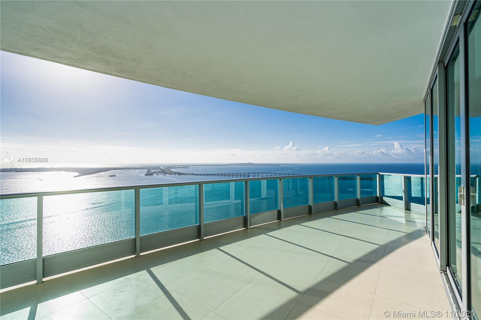 Breathtaking water views from this spacious home in the sky with private elevators! A must see!  Featuring 4-bedrooms & 4.5 baths, this Southeast corner unit has unobstructed breathtaking direct water and city views. This home flows all the way from the east to the west of the building and provides you with 270 degree views.  This light filled home features modern beige tile floors, gourmet/ Italian cabinetry with stainless steel SubZero refrigerator and Miele appliances.   Three balconies with panoramic views. Two parking spots plus free valet services are also included. The amenities are first-class offering a Full Gym, Health Spa, Club Room, Roof-top Party Room, infinity edge waterfront pool, cabanas & jacuzzi.   Vacant, easy to show!! Will not last! Now accepting Bitcoin.