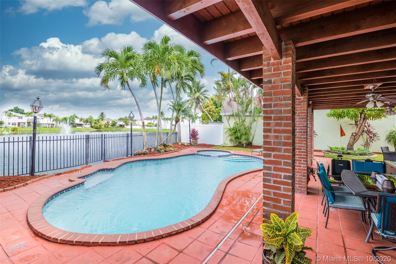 Lakefront & Pool paradise in the highly sought after Panache Community with amazing lake and fountain view! Move right in to this large 4 Bedroom, 3 Full Bath home with 2 car garage and a 4 car driveway in West Kendall. Huge Owner's Suite w/ dressing area & 3 other bedrooms all with water/lake views. First floor features a large living room and formal dining room with vaulted ceilings. Kitchen features an Island, and SS appliances incl 2 refrigerators. Relax in your backyard paradise w/free form pool with whirlpool & a covered patio. Accordion hurricane shutters throughout. Located in the desirable community of Panache, with amenities such as club house, pool, tennis courts and super low HOA fees, close to great schools, hospitals, public transportation, highways, supermarkets, and more.
