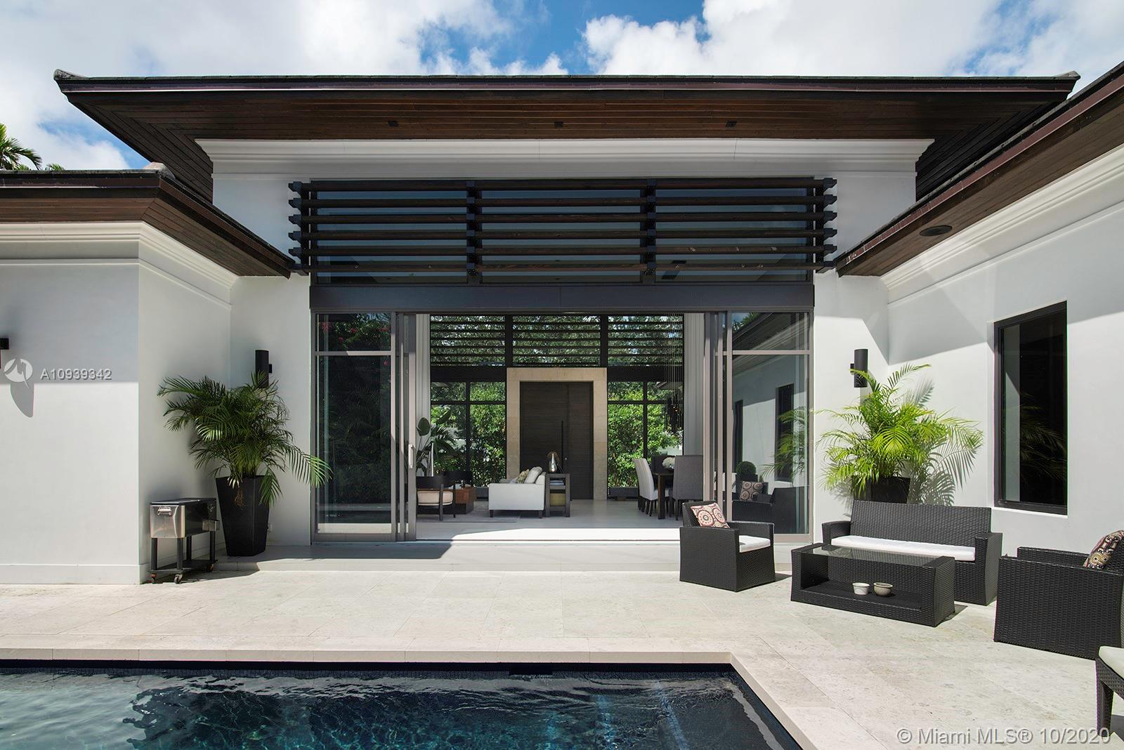 Tropical Modern new construction home in the most sought after section of Coral Gables. This trophy property was designed by award winning Dunagan Diverio Design Group. Truly a unique home this custom build features oversized windows, high ceilings, & clean lines with touches of warm woods & natural stone textures. The inviting open floor plan & design of the home emphasizes indoor/ outdoor living for entertaining all year long. Stunning Mia Cucina Italian eat-in Kitchen features top of the line Sub Zero & Wolf appliances w/ bar & wine display. Luxurious Master Bedroom is lined w/ a wall of glass overlooking the pool & features large walk in closet & spa-like Master Bath. Large yard w/ pool & private outdoor shower. Complete smart home. Garage w/ double height ceiling built for a car lift.