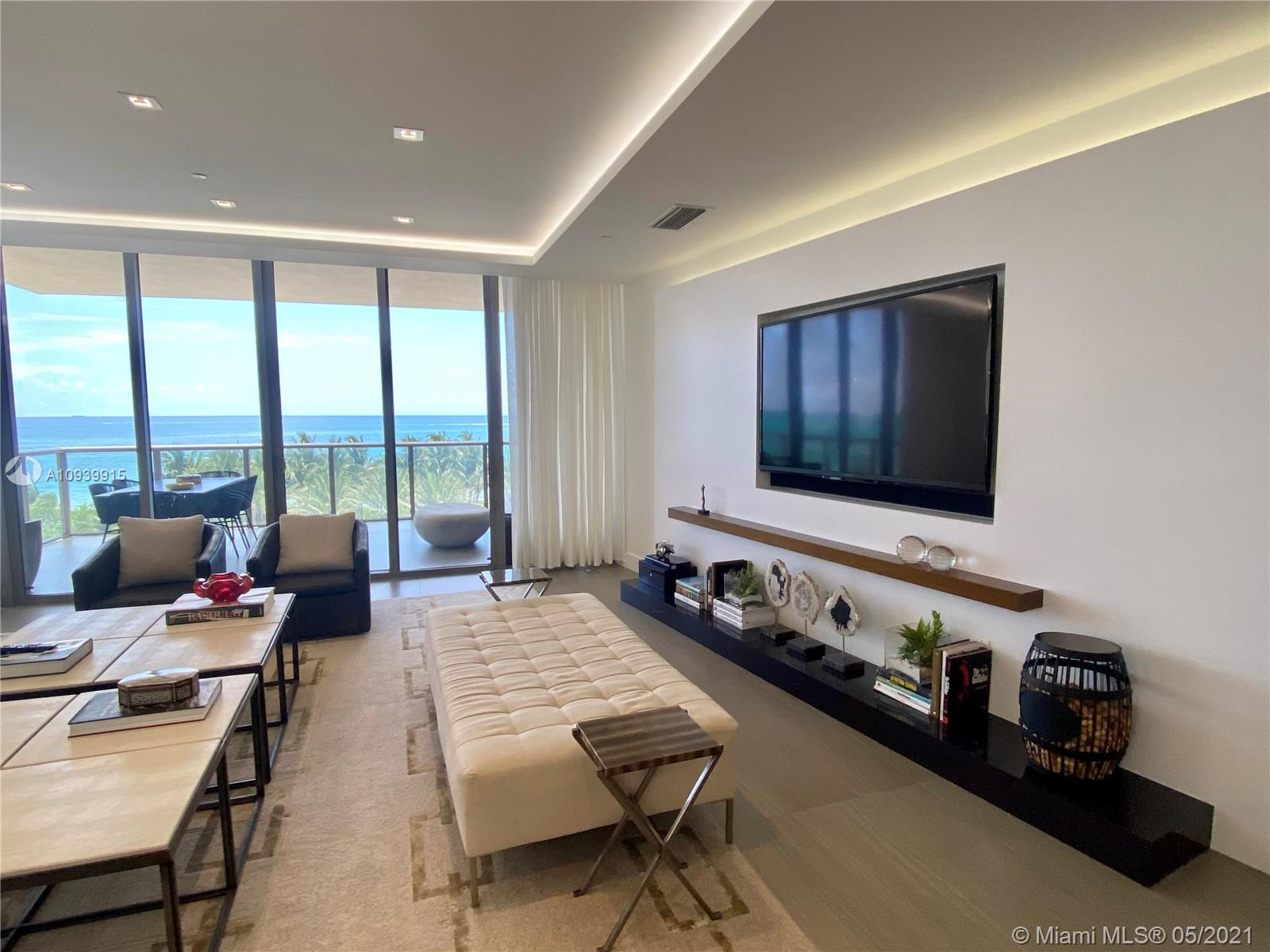Sophisticated most desirable & best prices corner residence offered furnished. Professionally designed & decorated by Steven G with 3 spacious bedrooms + DEN, oversized master suite with sitting area & large en-suite bedrooms, media/family room, breakfast nook, formal dining room, large laundry room & 3 private terraces. Kitchen offers 2 sinks, 2 refrigerators, 2 wall ovens & 2 dishwashers as well as built-in wine refrigerator & coffee maker. Sub Zero appliances. 5-star amenities such as 24 hour concierge, room service, private oceanfront cabanas, 4 pools, 3 private restaurants, 14,000 SF Remede Spa & much more.