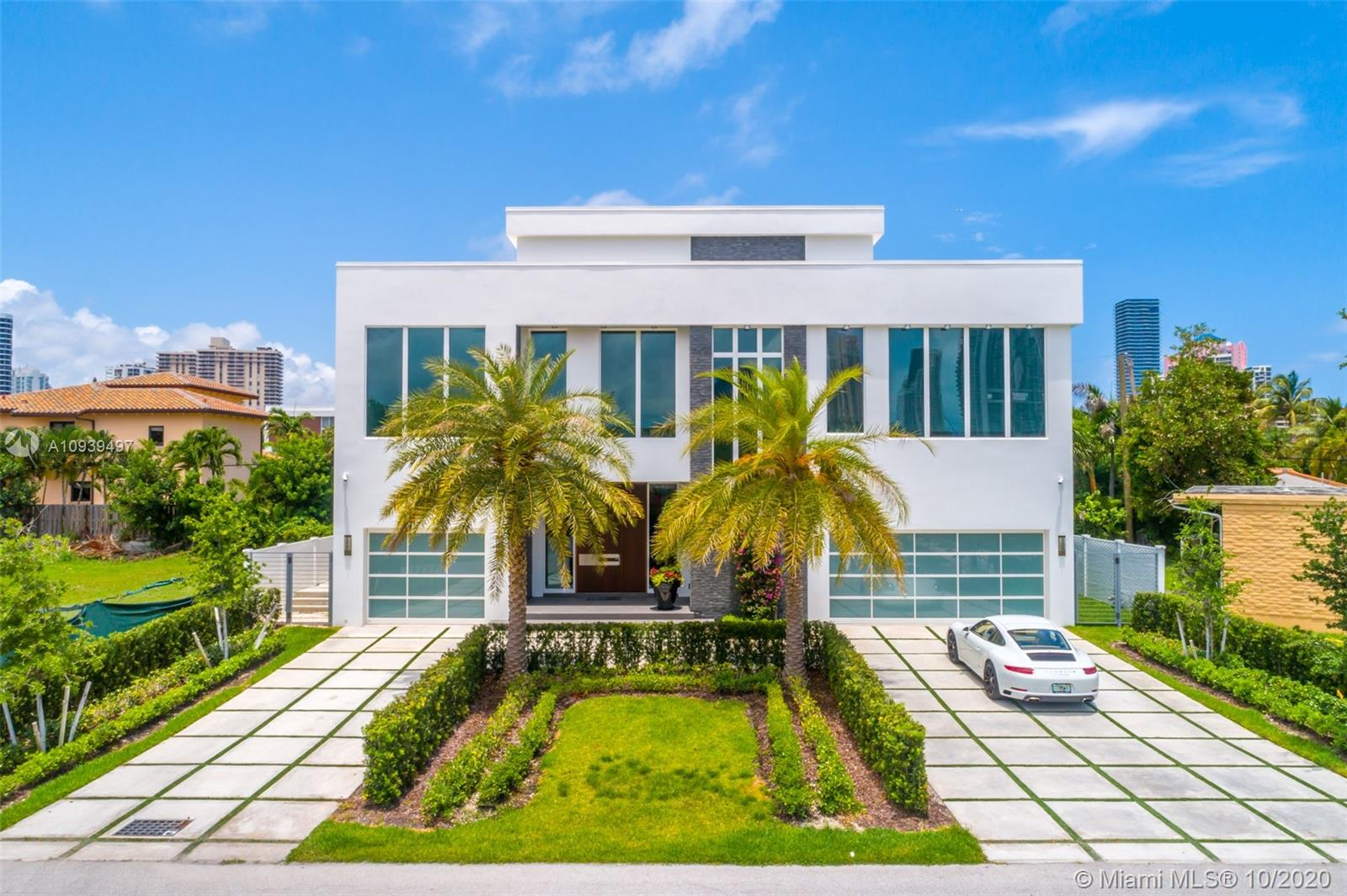 Newly built and designed to the nines, this modern masterpiece offers 5 grand bedrooms, 5.5 bathrooms, an office, a true master chef's kitchen and breathtaking ceiling height that make for a one-of-a-kind home just walking distance from Sunny Isles Beach. Interior finishes throughout this 6,254 sq ft gem include Roberto Cavalli floors, custom light fixtures, dropped ceiling lights, and accent walls to list a few.