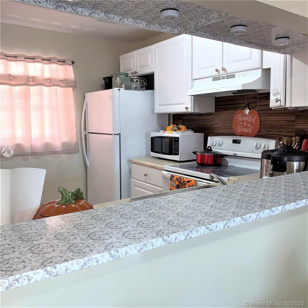 Great for investors 2 bedrooms 2 bathrooms, Balcony with a storage room 800 SQ FT freshly paint, all tile throughout, corner unit tenant occupied with contract to 07/31/2021 paying $1,250.00 with last and 1-month security good condition