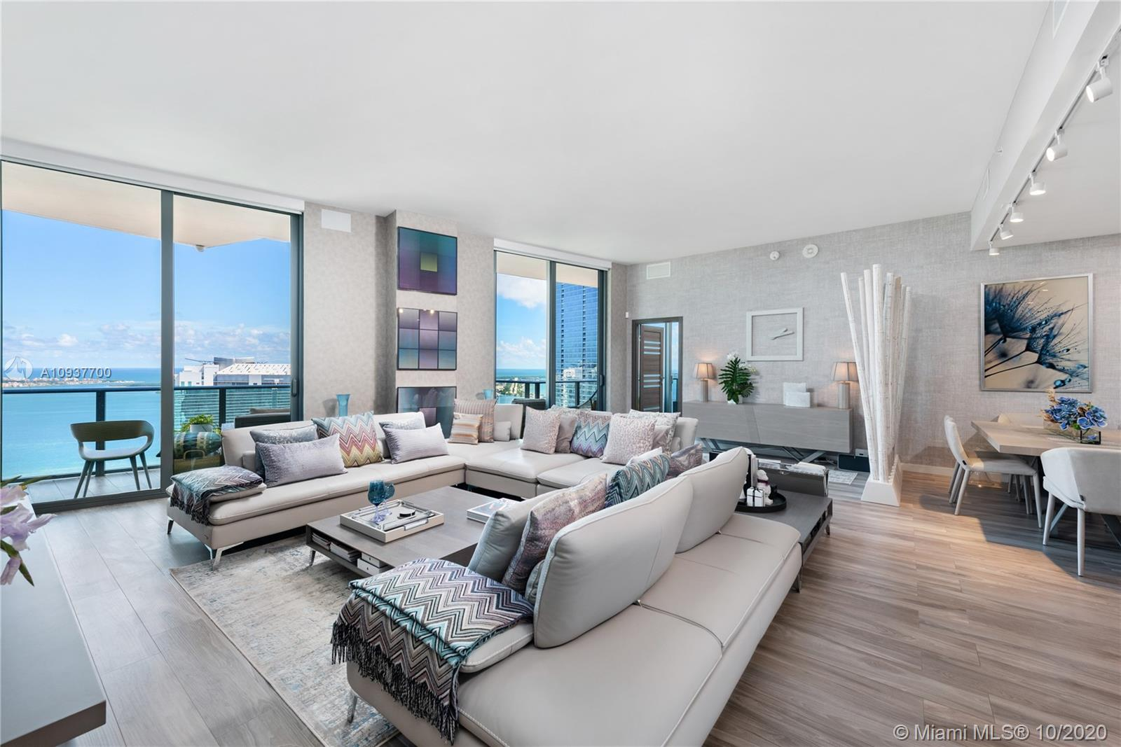 LUXURY IN THE SKY! Designer appointed 3 Bed+Den / 3.5 Bath Penthouse in luxurious SLS Brickell with over $250K in upgrades. Best Line at SLS. PH completely upgraded w/luxury end-finishes. Top-of-the-line Bosch and Subzero appliances, 10-foot ceilings, exquisite wall paper accents, sleek wood like porcelain floors, Italian custom doors and closets. Floor-to-ceiling glass windows open to large balcony w/panoramic views of ocean & Miami skyline. Control 4 Advanced Home Automation System for lighting, temperature & blinds. Master Bath w/tub & shower, Italian cabinets, LED mirrors and top-of-the-line Toto automated toilette/bidet. Amenities: fitness center, rooftop pool, full-service spa, terrace w/200 ft-long pool, cabanas, full-service concierge, kids room, party room, and top restaurants.
