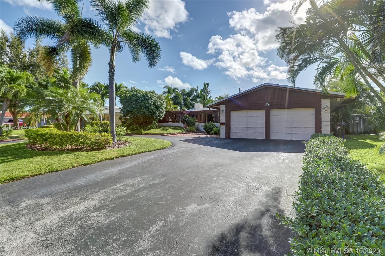 This beautifully renovated move-in ready 2/2 home in the highly sought after Coral Ridges Isles in Ft Lauderdale is just a short bike-ride from the beach. The spacious 1861 total sqft home with an open floor plan includes high quality, brand new flooring throughout, a newly remodeled bathroom and a newly remodeled living room fire place. Both bedrooms are very large and spacious. The kitchen has gorgeous granite countertops, premium hardwood cabinets. Kitchen also has a large ice maker and a wall-mount pot filler faucet. The backyard has a screened in porch. This beautiful home is equipped with central A/C and Bermuda style roofing. this house is a must see!