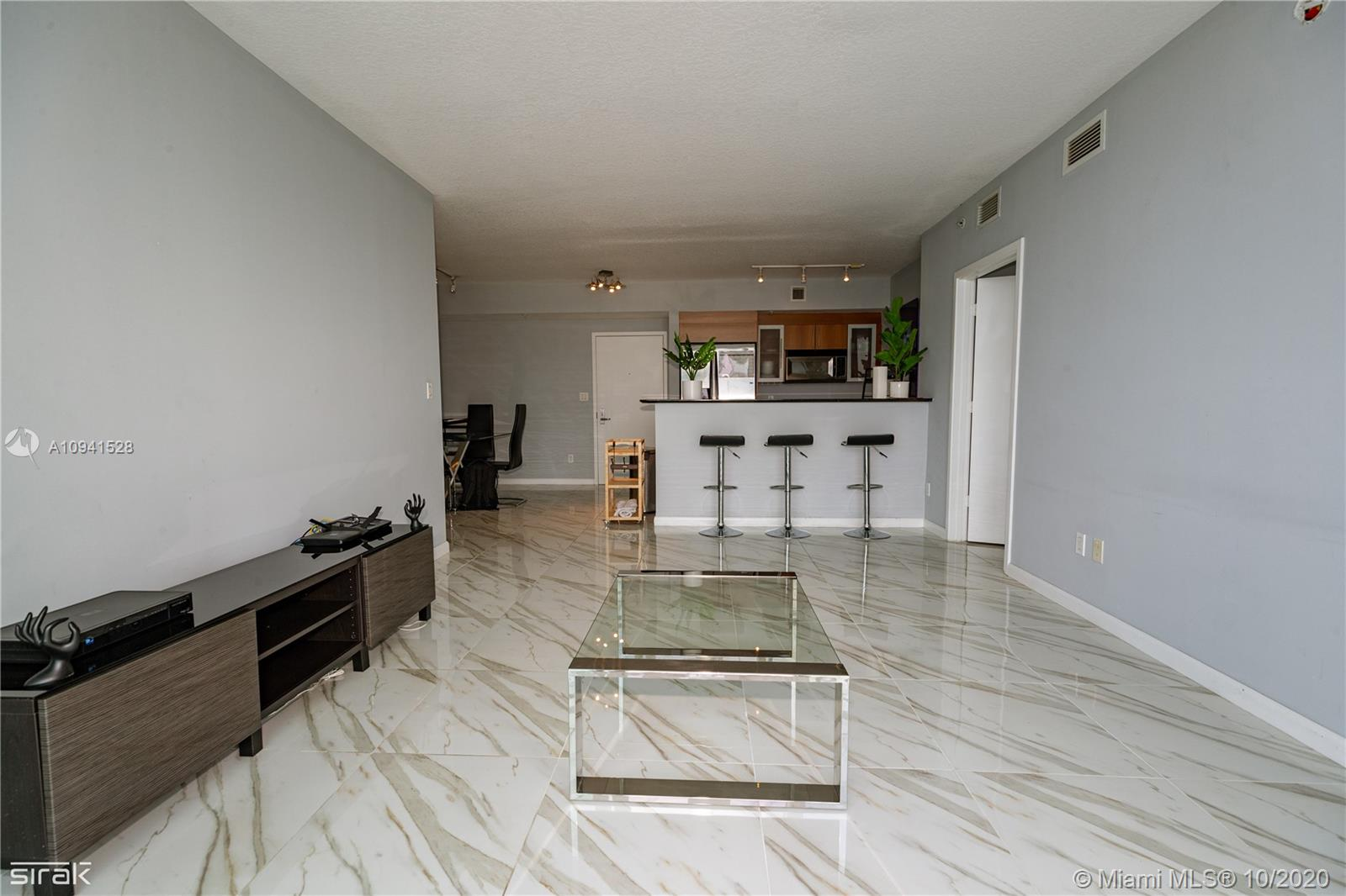 Beautiful 2 bedroom 2 bathroom split plan condo with views of Biscayne Bay, Port of Miami, and Downtown. Condo has Italian kitchen cabinets with stainless steel appliances, and marble bath countertops, with porcelain tile floors throughout. Condo amenities incl: 2 swimming pools, Jacuzzi, 2 Fitness Centers, 2 Party Rooms, Conf. Room, Convenience Store, and 24 hrs Security, Valet, and Concierge. Centrally located within minutes of SoBe, Grove, Gables, Design District and Airport.