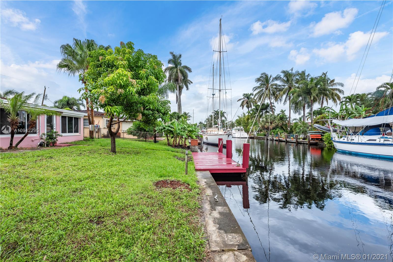 Beautifully waterfront home in Fort Lauderdale with Ocean Access & No Fixed Bridges. This single family home features Hurricane Impact Windows & Doors, open layout with tile flooring in the main living area & new wood flooring the bedrooms. Kitchen with newer SS appliances. Walk out to your spacious & fenced-in backyard with a paved overhang overlooking the dock & water. The front of house features a large front yard, long driveway and a car port with direct access to the kitchen. This beautiful home is sitting in a great location whether your traveling by boat or car! A Must See! Easy To Show Just Schedule Your Appointment Today!