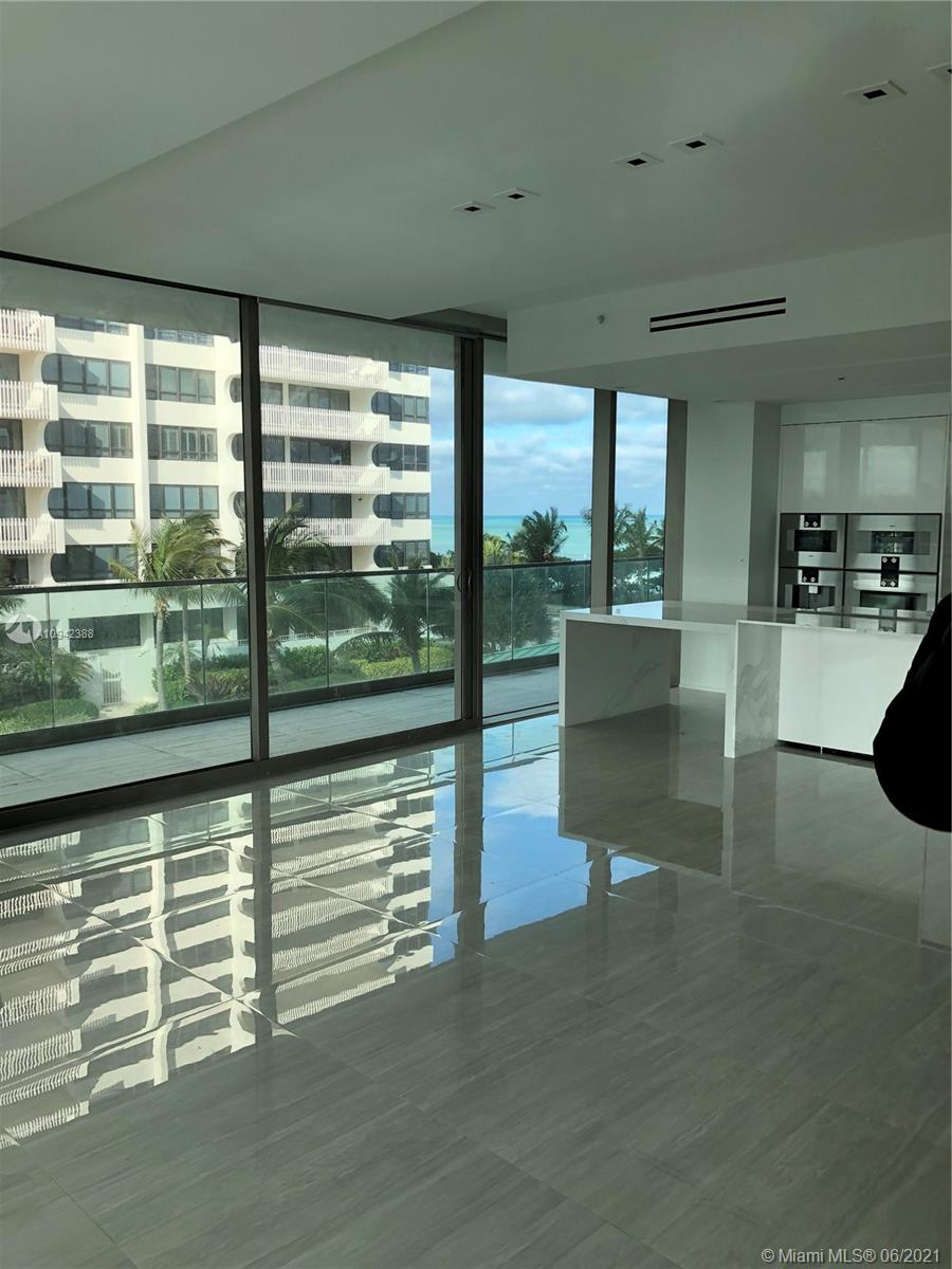 10203  Collins Ave   411-1