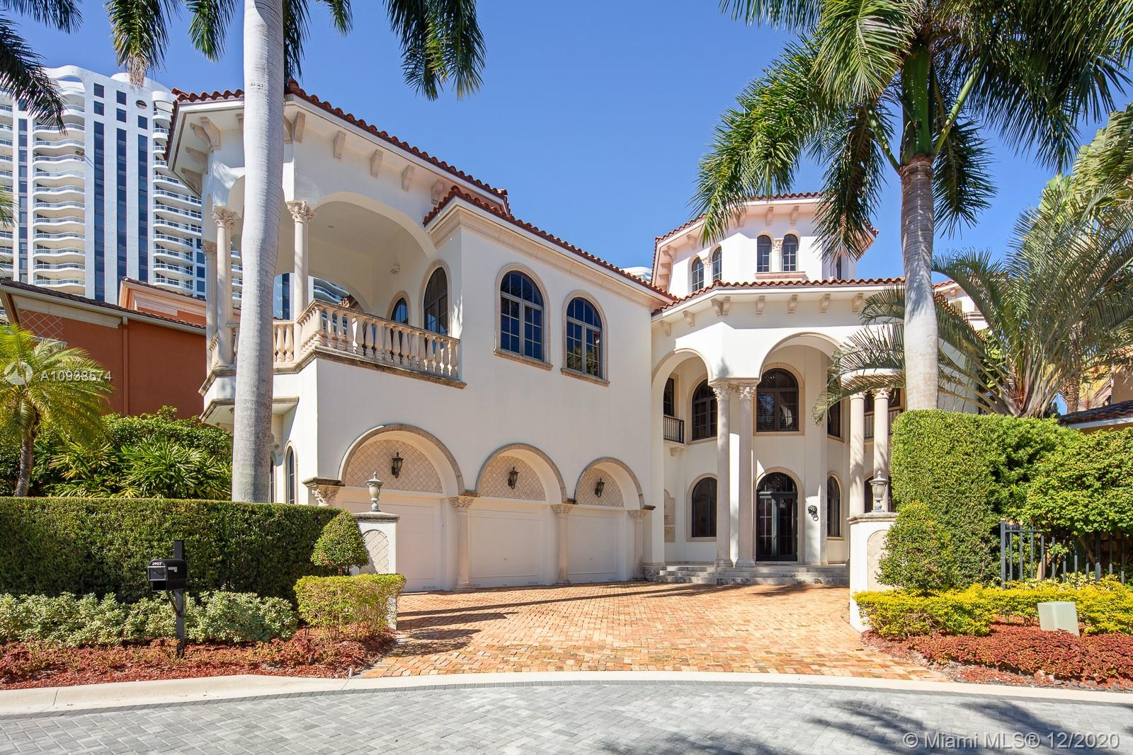 Welcome to the grandest of Island Estates homes. Professionally designed, 5 beds / 5.5 baths with 40' ceiling, impressive grand staircase, magnificent cinema! Extra large game / family room, 600 gallon saltwater aquarium, huge patio, infinity edge pool & elevator.