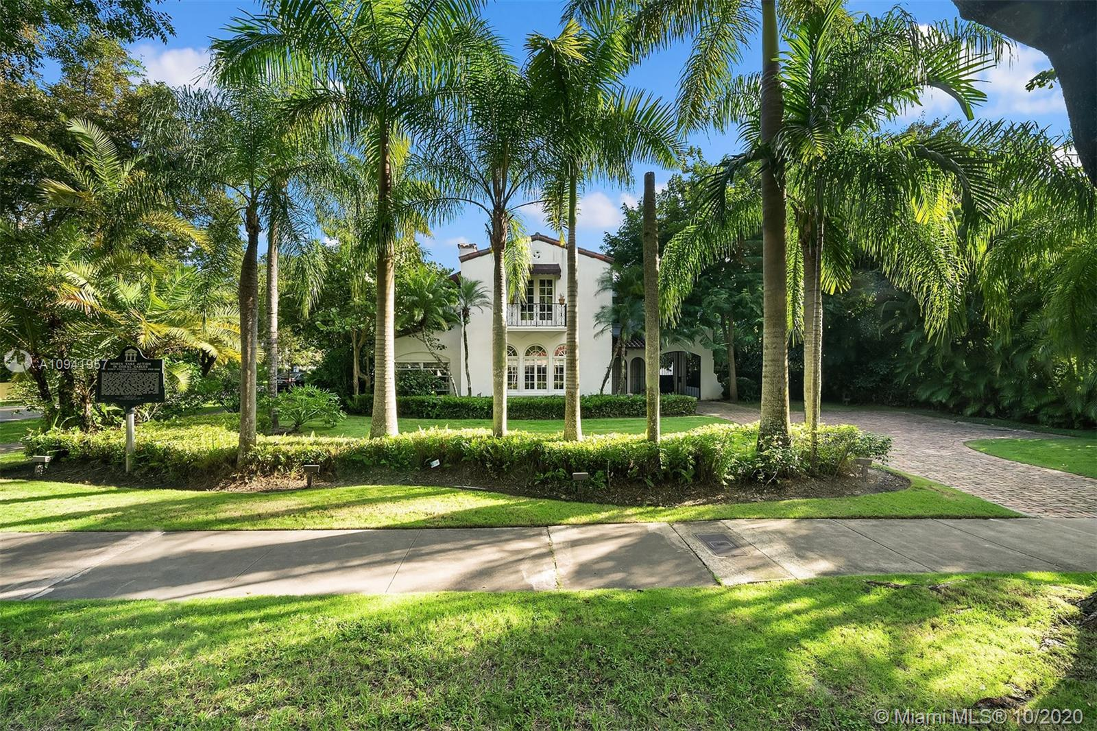 Embrace the history and lifestyle of Coral Gables with this two-story Mediterranean Revival residence. Stepping inside this beautiful home is like stepping back in time, with its arched windows, iron railing staircase, Spanish and terracotta tile, and original Dade County Pine floors. The main home includes three bedrooms with balconies, two bathrooms, a chef's kitchen with antique white cabinets and high-end appliances, and a living room with a gas-fueled fireplace for additional comfort.  Nestled in a lush, leafy garden with fruit trees are a 1/1 guest suite, lagoon-style pool, patio, children's playground and garage. This home is minutes away from cafes, restaurants, shops and a selection of premier schools.