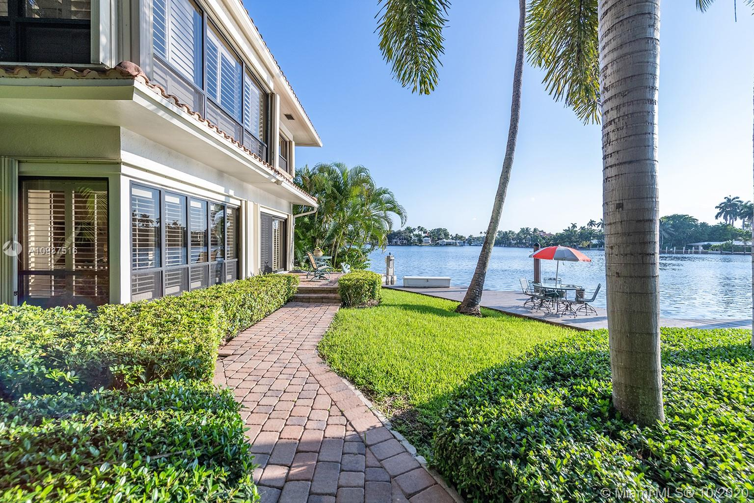 Enjoy the benefits of a private waterfront home with boat dockage but with the maintenance free ease of a condominium.  Rare and highly desirable first floor corner residence at Lake Shore Condominium features an open floorplan with spacious living/dining room, separate reading nook, home office and a custom Poggenpohl kitchen and master bath.  Impact windows and plantation shutters throughout.  Private 1 car garage with additional car parking in front of the garage.  Enjoy panoramic views of Sunset Lake from the private, walk-out patio.  Boat slip with power can accommodate a 60' boat with easy access to the Intracoastal and ocean.  Lushly landscaped tropical oasis with only 5 owners is within close proximity to the beach, downtown/Las Olas and airport.  Furnishings negotiable.