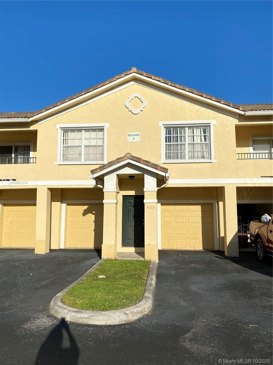 Well maintained and hardly used 1 bedroom 1 bath home with attached 1 car garage plus 1 assigned parking in gated family community.  Beautiful wood laminate floors, washer and dryer conveniently located inside home.  Low HOA includes water, roof, common area maintenance and insurance , valet trash pickup and central alarm monitoring.  Amenities included in HOA are clubhouse, gym, pool, kiddie park area and tennis court.  Home has a newer smart thermostat and AC is only 4 years old.  Property is close to major highways, restaurants and shopping centers.
