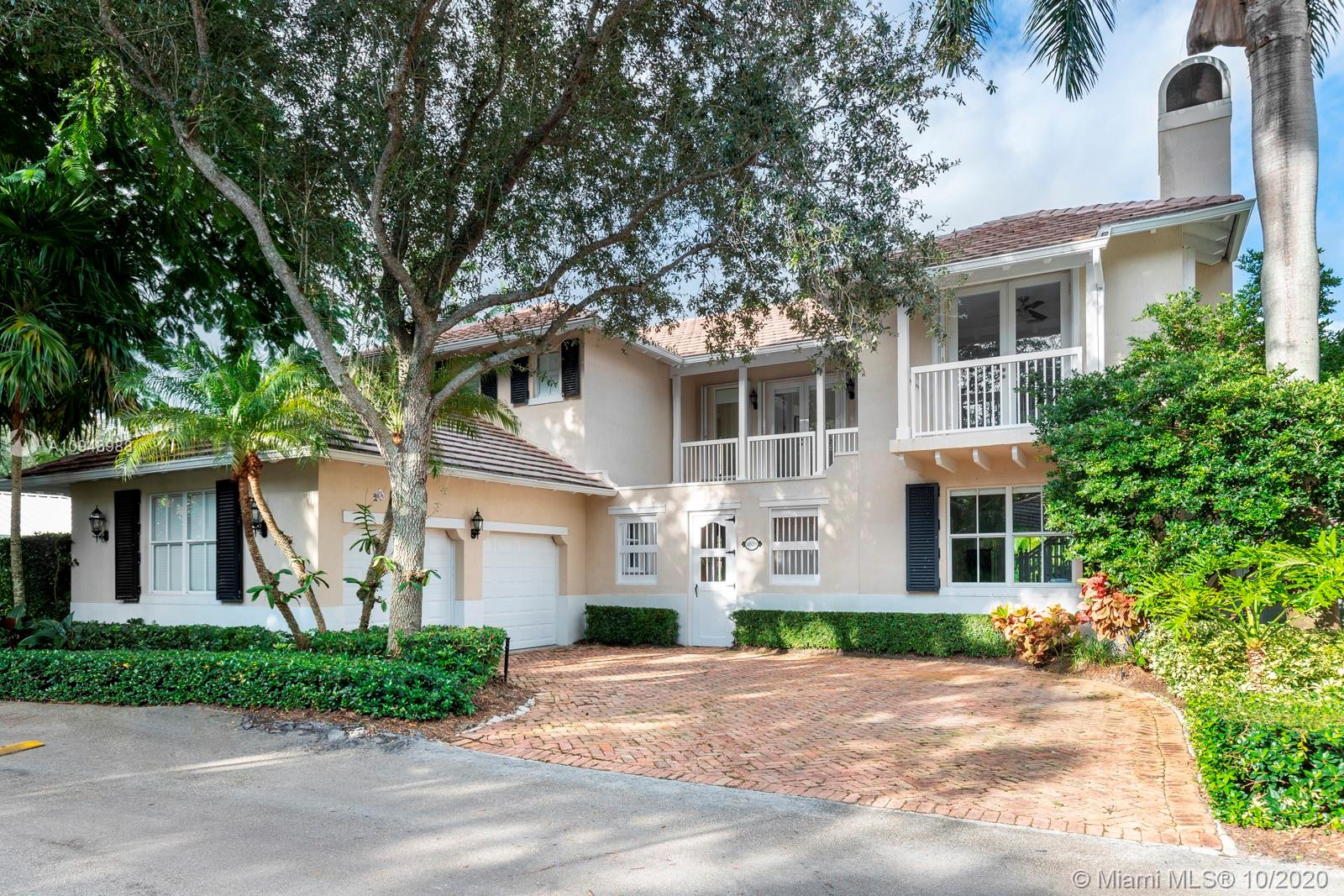 Fall in love with this perfectly located home in the community of Parkside Village - small gated neighborhood in the the heart of South Miami. This village is unique, quiet, lushly landscaped and offers tranquility and privacy while still being within walking distance of Miami's best schools, the shops at Sunset place, and next to Dante Fassell Park. 8520 SW 57th Path is just one of 20 homes in this community. A four bedroom, four full bath residence with 3,547 square feet of living area, this two story home features wood floors in every bedroom, a large master suite, and lovely pool and yard overlooking a park like setting. This is a great family home in South Miami in a central location.