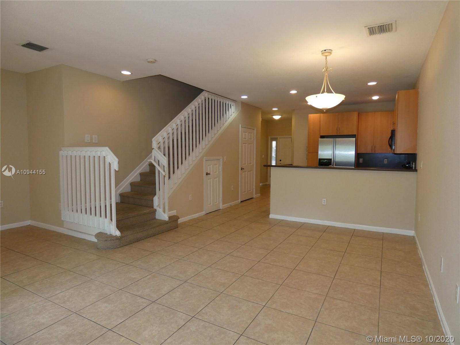 Two-story 3 Bed /2.5 Bath townhouse in a safe and quiet gated community.  1 car garage.  Built in 2008 and has Impact windows and doors.  Stainless steel kitchen appliances and full size washer and dryer.  Tile and laminate wood plank flooring throughout.  OK to lease immediately. This gated community has low maintenance fees and a beautiful community pool.  Located within a short distance from the beach, shopping, and downtown Fort Lauderdale!