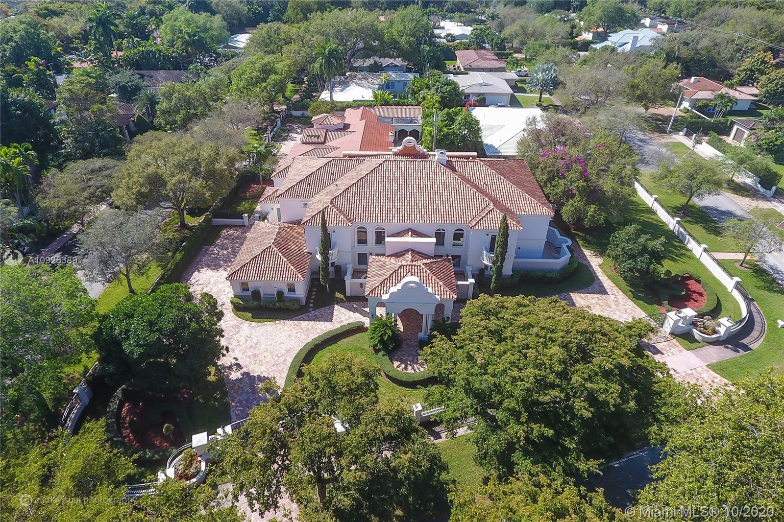 Absolutely stunning Estate in Coral Gables. Completely remodeled in 2017 with no expenses spared. Almost 8,000 adj sq ft with 6 suites, 1 office and #3 car garage. The best finishes possible: Eggersman Kitchen, Miele Appliances, marble & wood floors, Savant automation system, Ornare closets and more. Remarkable corner house, surrounded by 3 streets on 29,800 SF. Large Terrace surrounding beautiful pool area, with Jacuzzi, summer kitchen with BBQ and cabana bathroom. Manicured gardens complete this astonishing home.