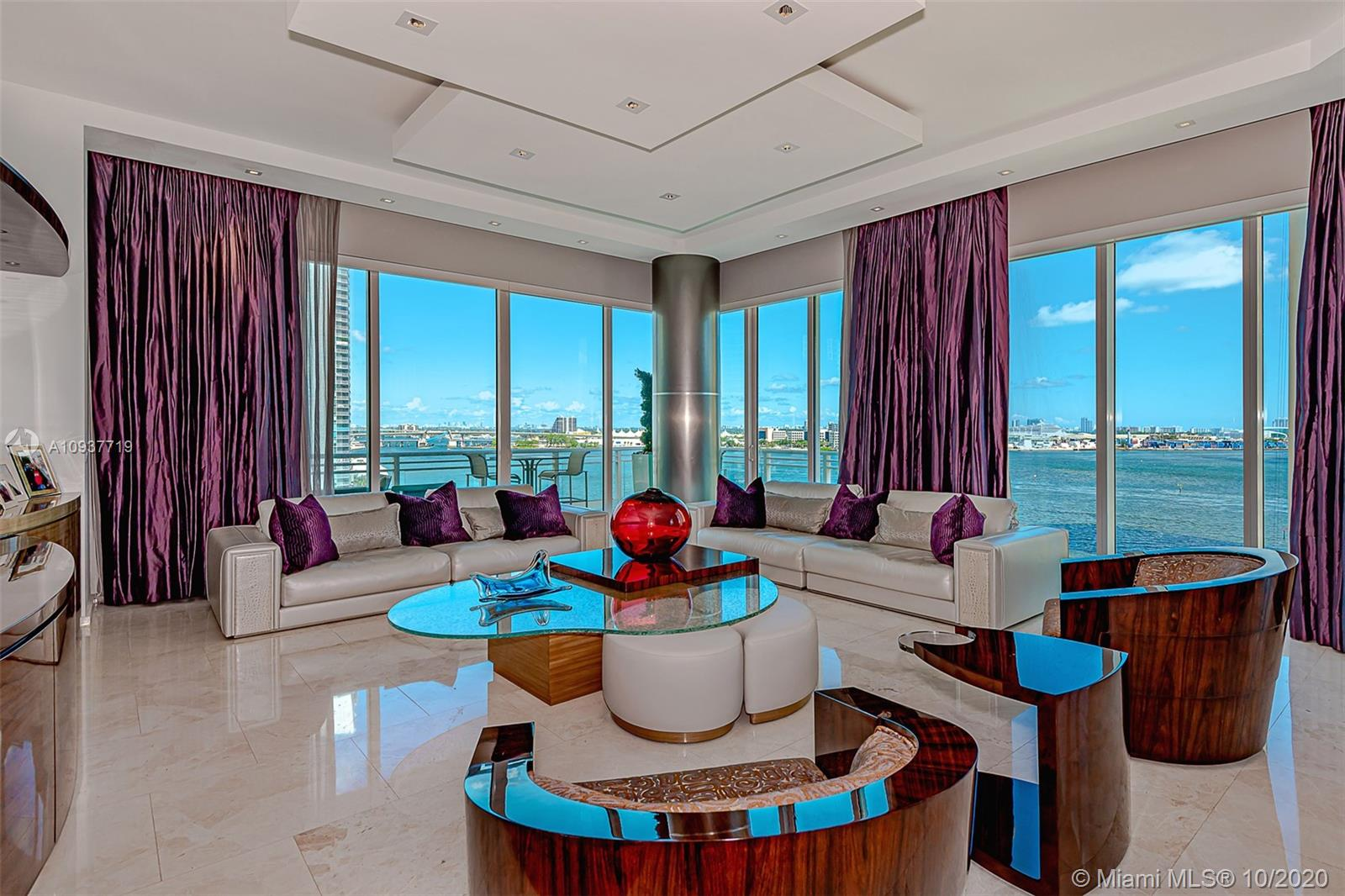 Spectacular corner unit in Asia, Brickell's most exclusive building w/only 123 units! Unit was remodeled and finished to perfection- no expense was spared. Floor-to-ceiling windows allow you to enjoy the stunning views of Downtown, river, and bay. Unit has private elevator, 12ft ceilings, top of the line kitchen & bath, and Creston system. Unique plan on line 03 with a spacious den that became a bedroom with a custom made closet. Two parking spaces included. There is a tandem. Brickell Key amenities include 2 parks, playgrounds, Restaurants, Market, Beauty Salon, Dry Cleaners and more.