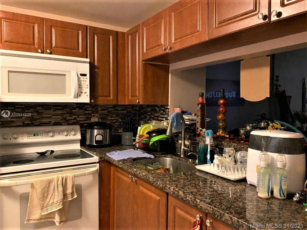 Special for investors 2 bedroom 2 bathrooms in good condition, first floor Unit, Tile throughout, Update Electric box, only $270 maintenance. lease end 11/10/2021 @1,250 per month