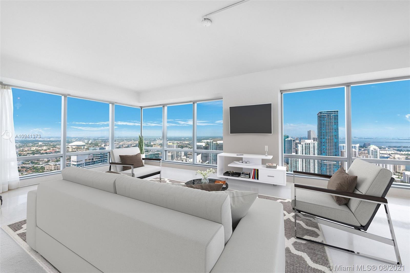 Prestigious Four Seasons Residences Miami… Stunning and incredible views of the bay and city from this spectacular 2 bedrooms / 2.5 baths unit on the 64th floor.  Enjoy all the amenities and lifestyle this building has to offer … room service, 24-hour concierge, gym, spa (Equinox), restaurants, business center, pools, valet service, and much more all at your fingertips.  With incredible finishes throughout and top of the line appliances, plus floor to ceiling windows that allow for great natural light, you can make this your dream home.  Walk to the shops, restaurants, and financial district but yet be in the luxury of Four Seasons.