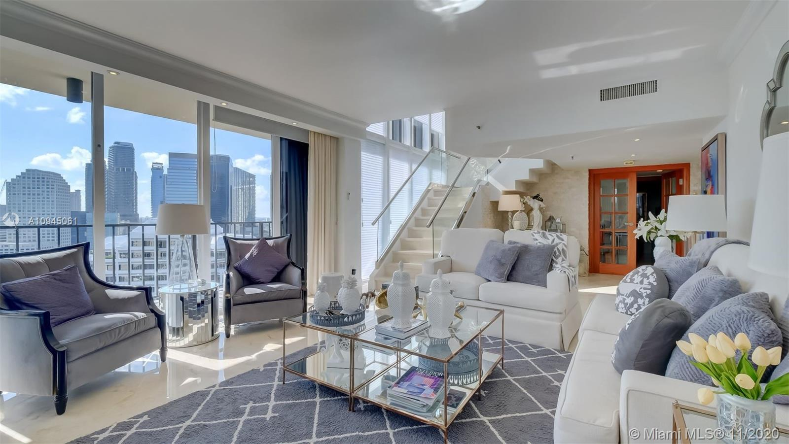 Contemporary, spacious, and recently renovated oceanfront 2-story residence in the prestigious Brickell Key. Live like royalty in this ample, luxurious penthouse with two entrances – direct elevator or interior staircase. The residence has a private elevator that opens up to its own private foyer. Accent walls throughout main floor and staircase to second floor. High-end stainless-steel appliances make the kitchen a showstopper along with glossy, modern cabinets and pantry, and quartz countertops. Floor to ceiling glass impact windows allow you to take in the beautiful ocean view from any room! Polished large format tiles throughout adds elegance and favors the openness of this beautiful 4 bed/3.5bath penthouse.Oversized master bedroom and bathroom to enjoy your year-round resort feel.